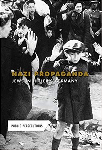 Nazi Propaganda: Jews in Hitler's Germany - The time of the Third Reich is one of the ugliest periods in human history. To execute Adolph Hitler's plan to destroy all Jewish people in Europe, Nazi propagandists demonized and dehumanized the Jews, leaving people desensitized to the discrimination and destruction heaped on them. This book details the way the Nazis turned a nation against a people, provides sidebars on people caught up in both sides of the great conflict, and outlines the ramifications of the persecution of the Jews.