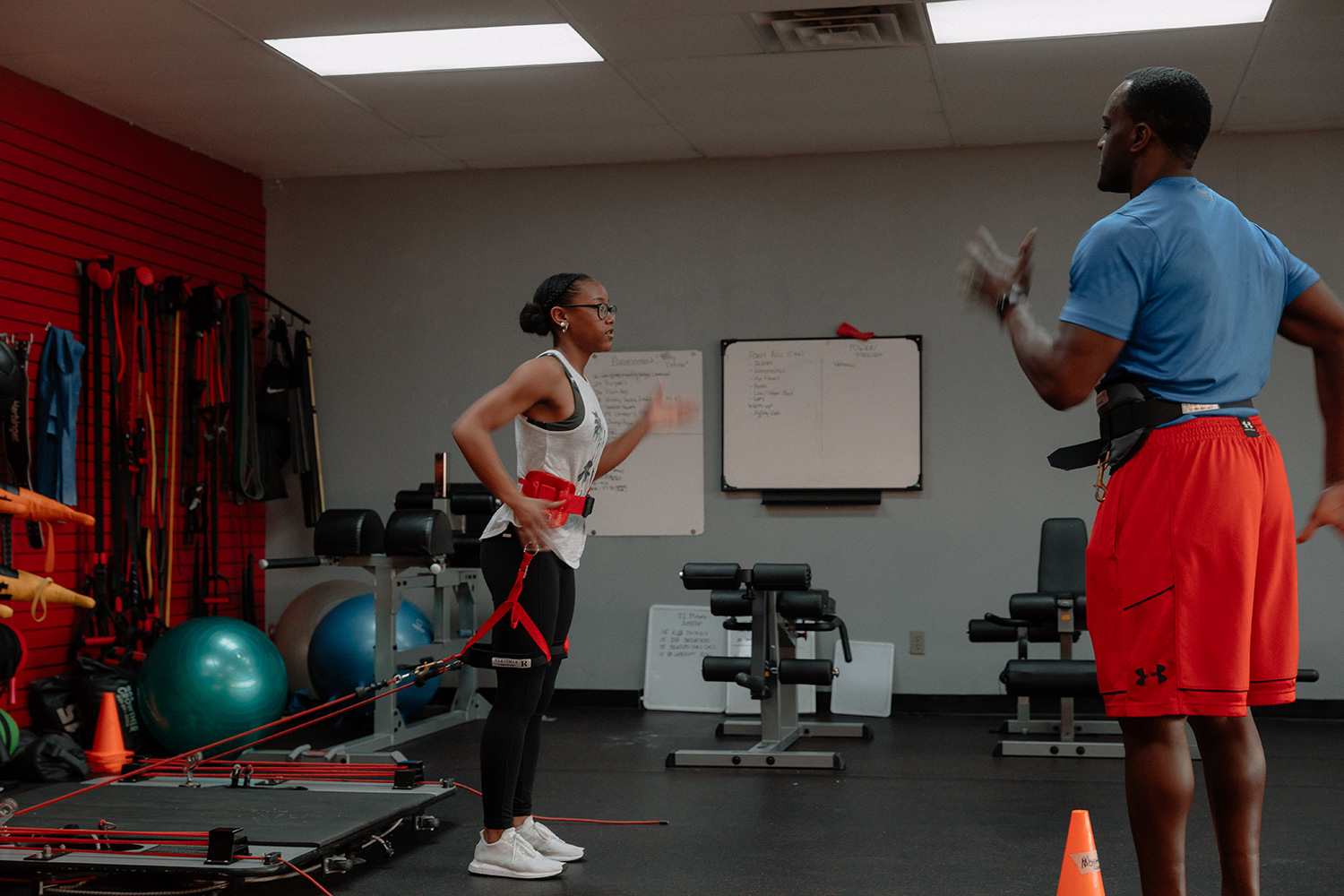 James A. Callins, CSCS helping a student athlete through strength training