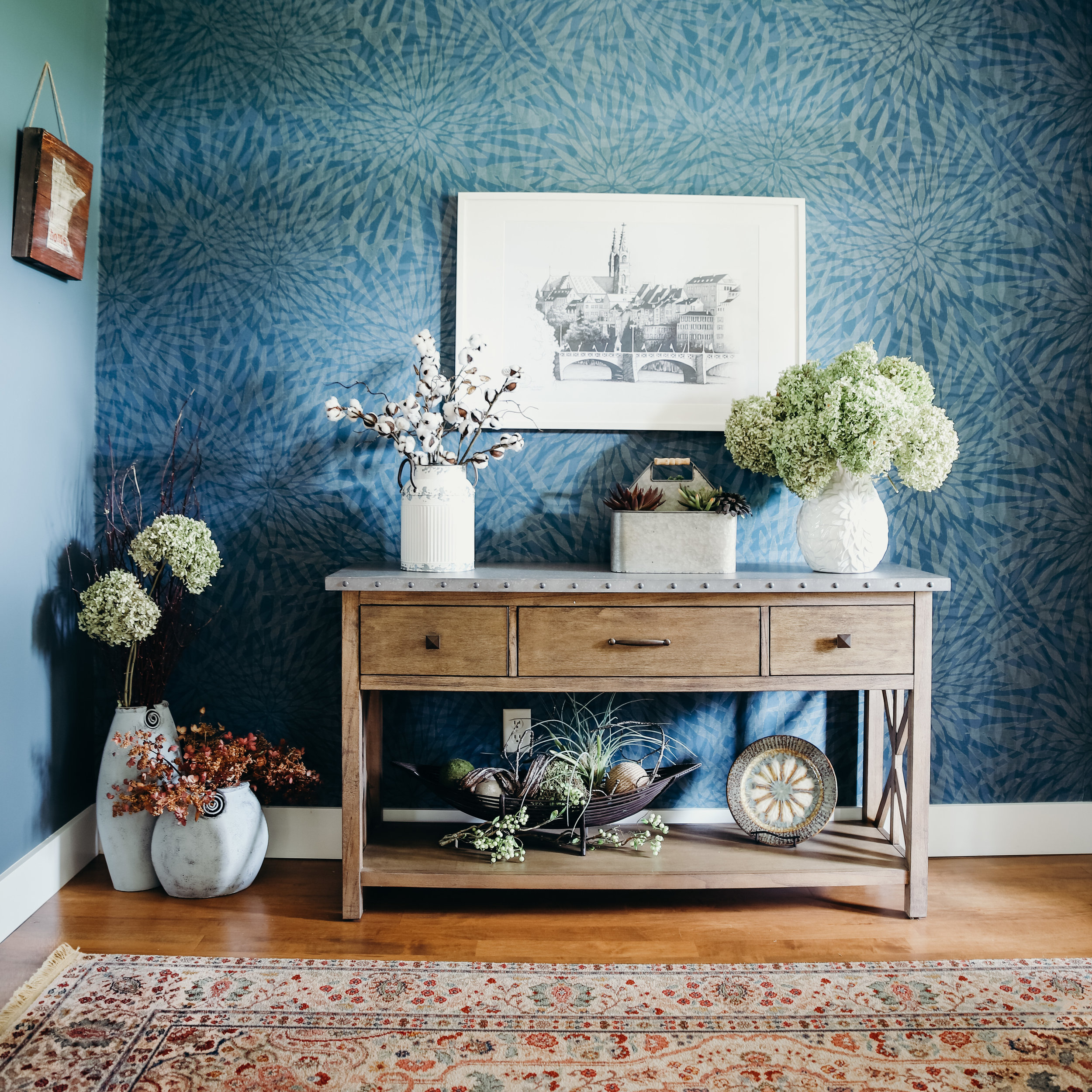 We made this entryway extra welcoming with large print wallpaper along a wall that seamlessly transitions into the paint color.
