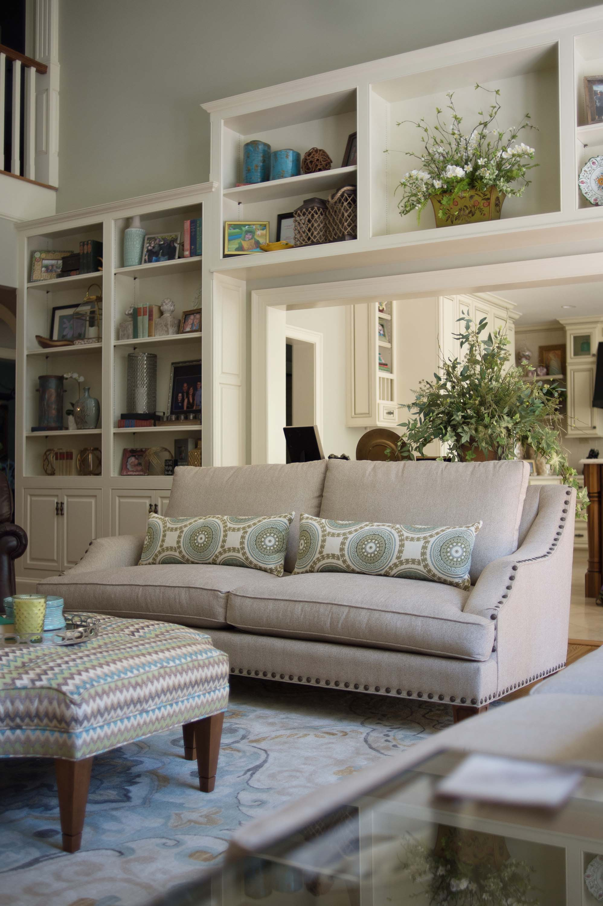 Living room with sofa, cabinet and indoor plants