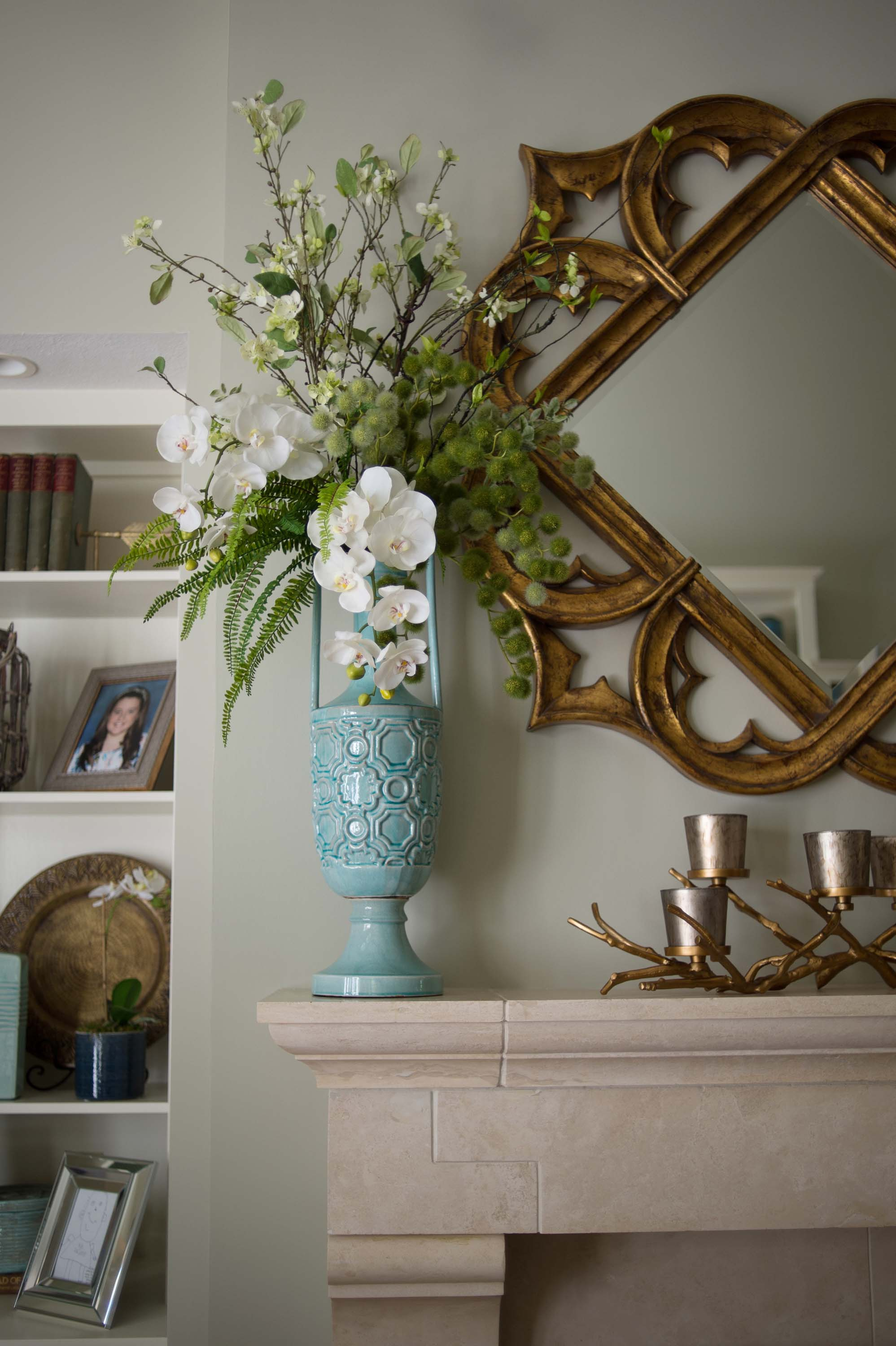 House interior with modern style mirror, and flowers