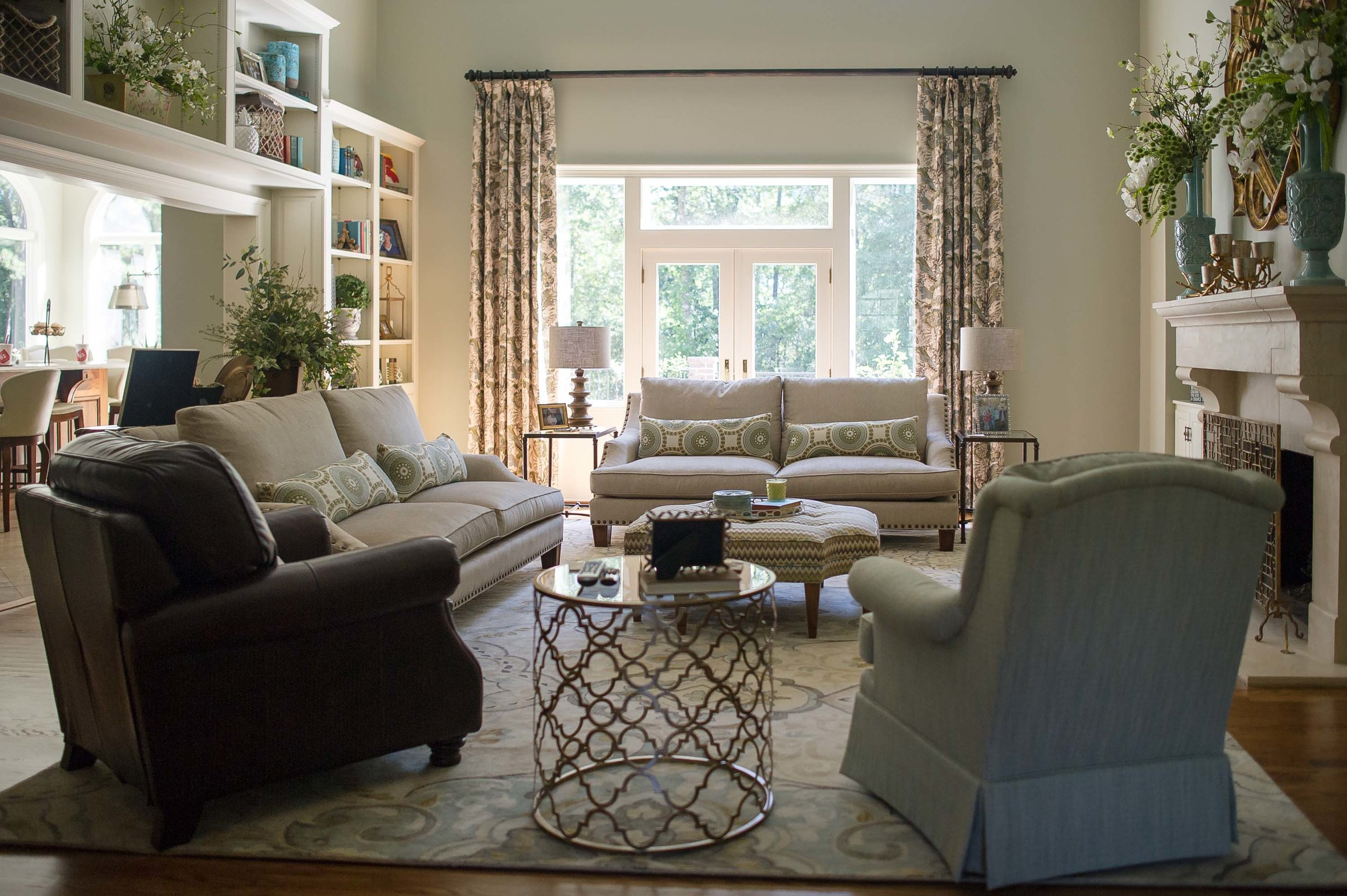 Living room with fireplace, sofa set and indoor plants
