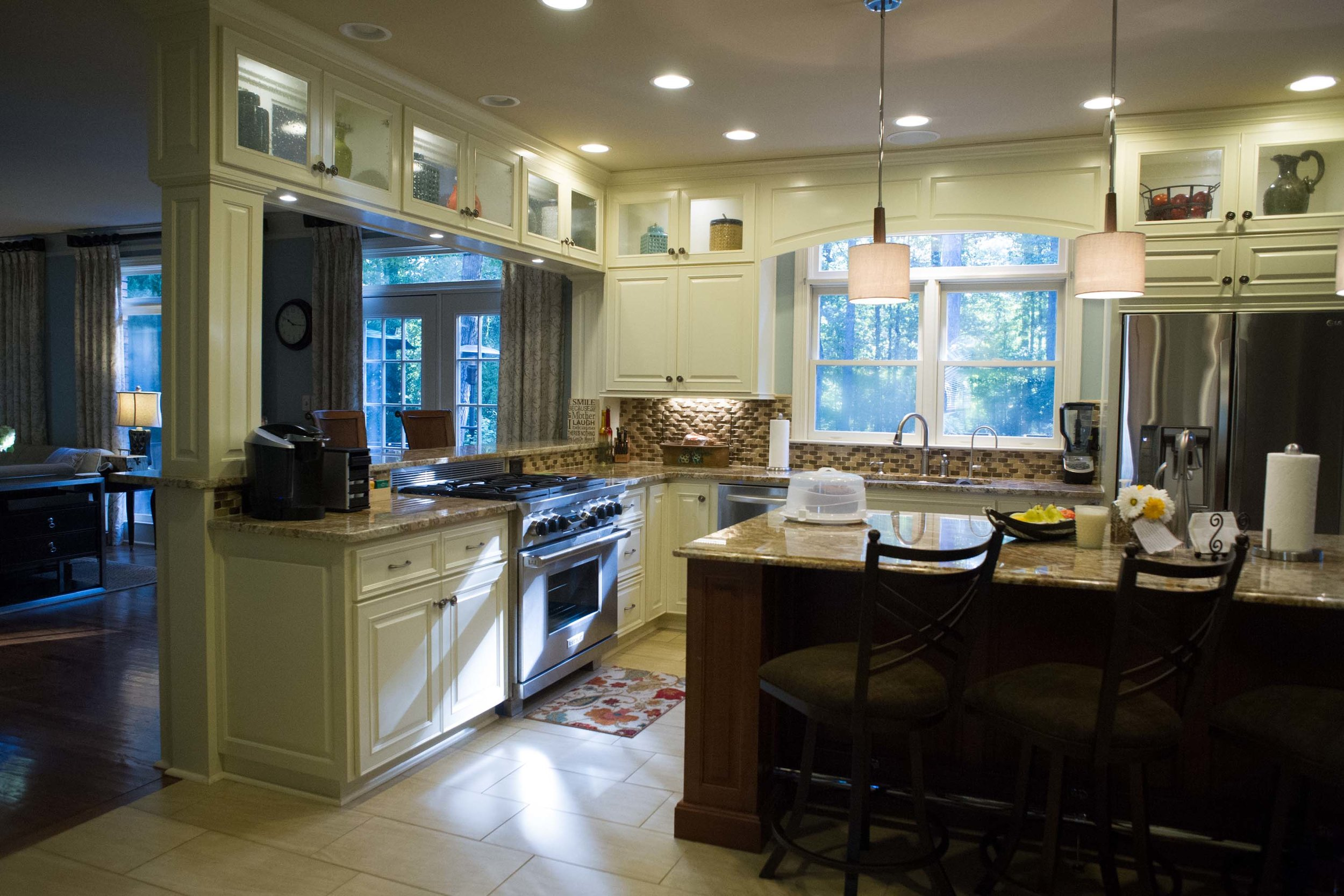 Kitchen with center island and breakfast bar