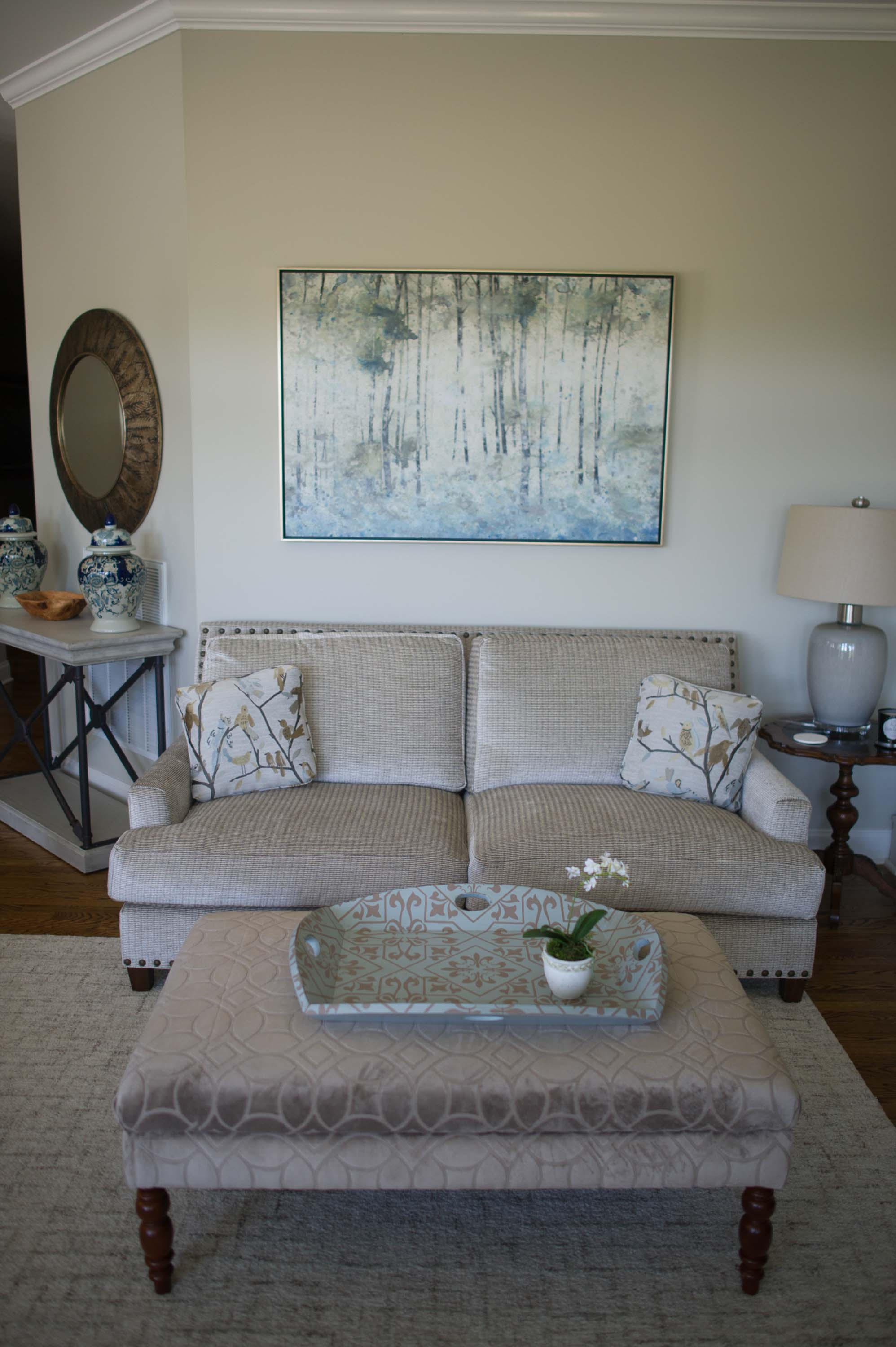 Living room with sofa, center table and artwork on the wall