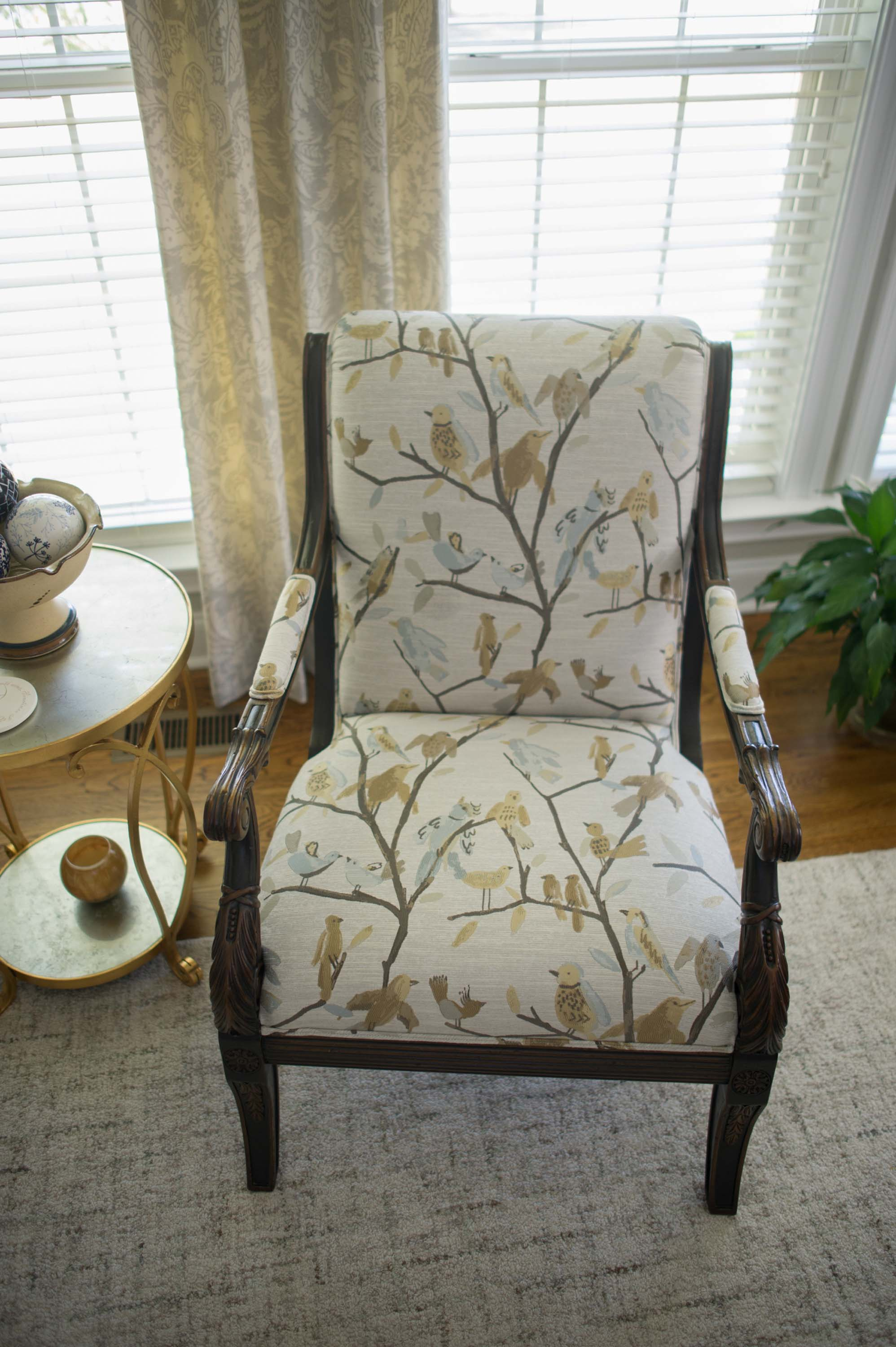 Wooden arm chair with soft seat and floral print