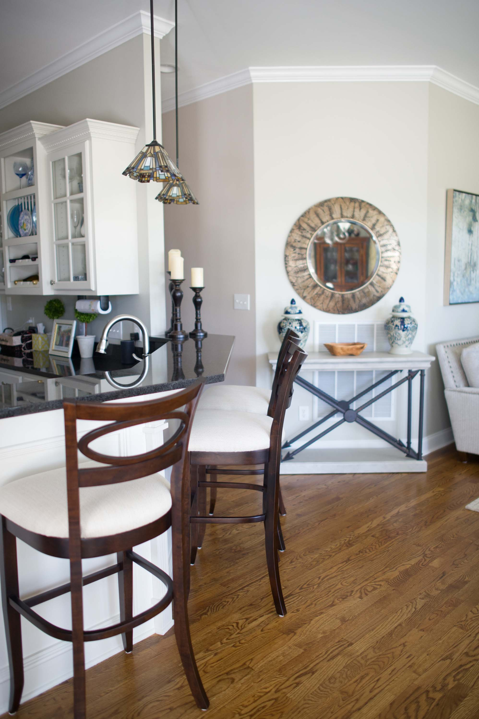House interior with hardwood floor, counter and stools