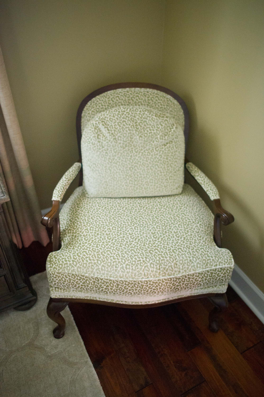 Soft seat wooden armchair on hardwood floor