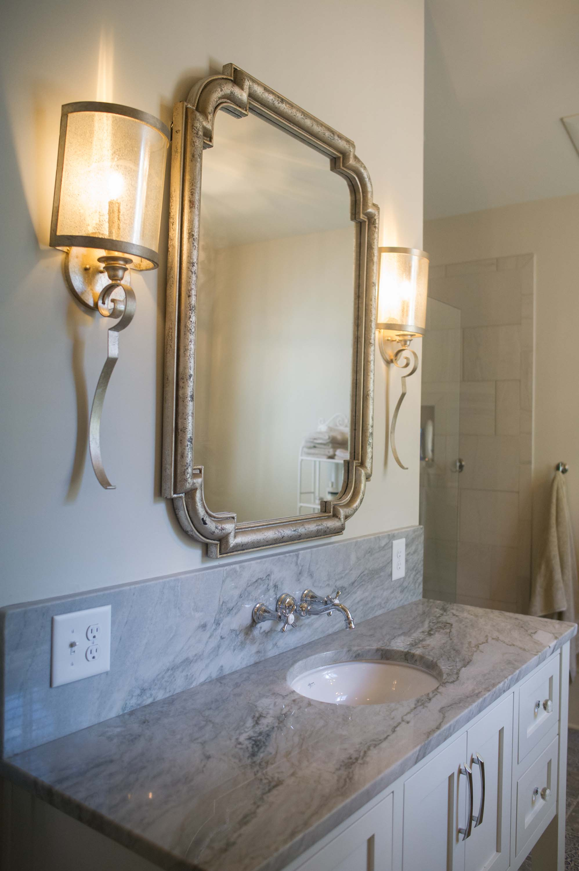 Bathroom with sink, ceramic countertop  and vintage style mirror