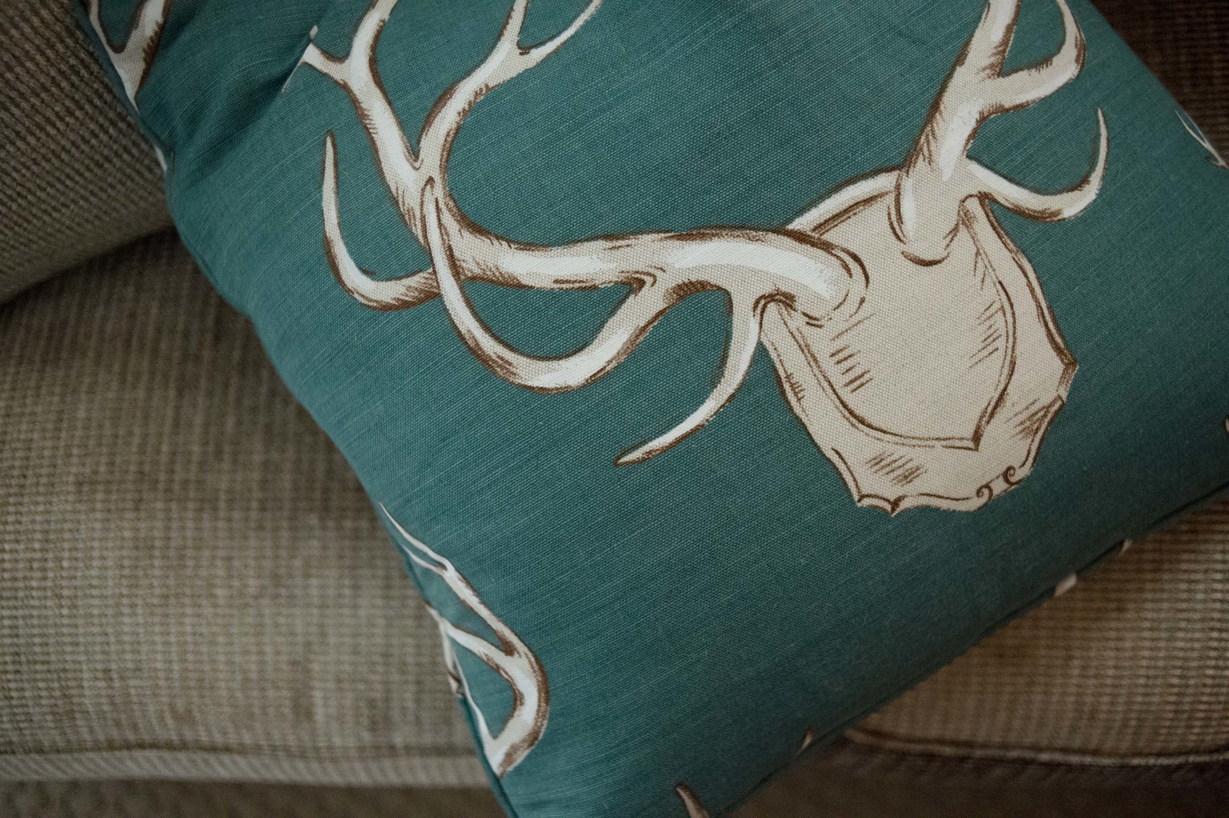 Green pillow on a sofa