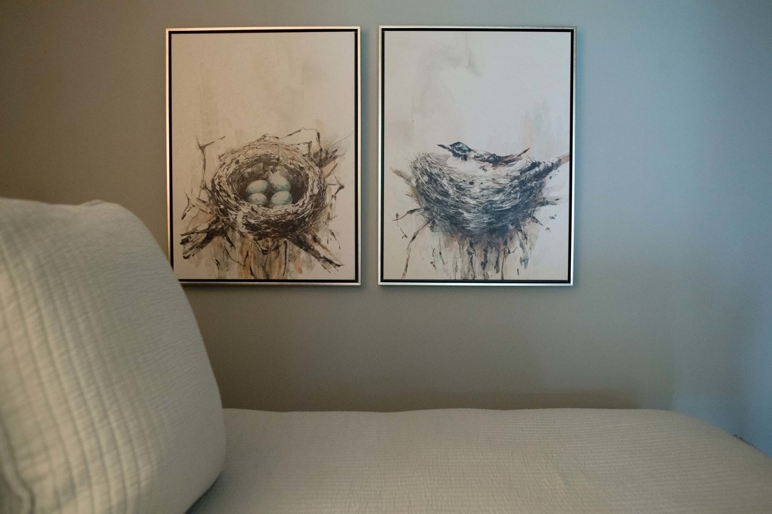 Bedroom with two set of artwork on the wall