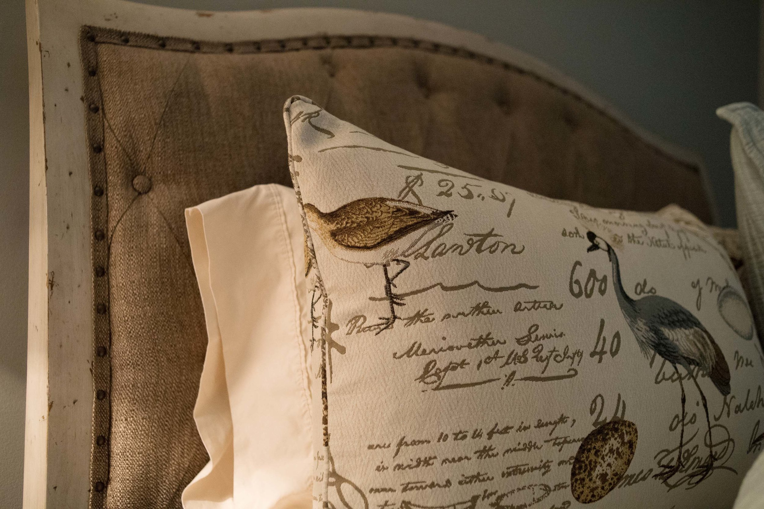 Vintage bed headboard and pillows on bed
