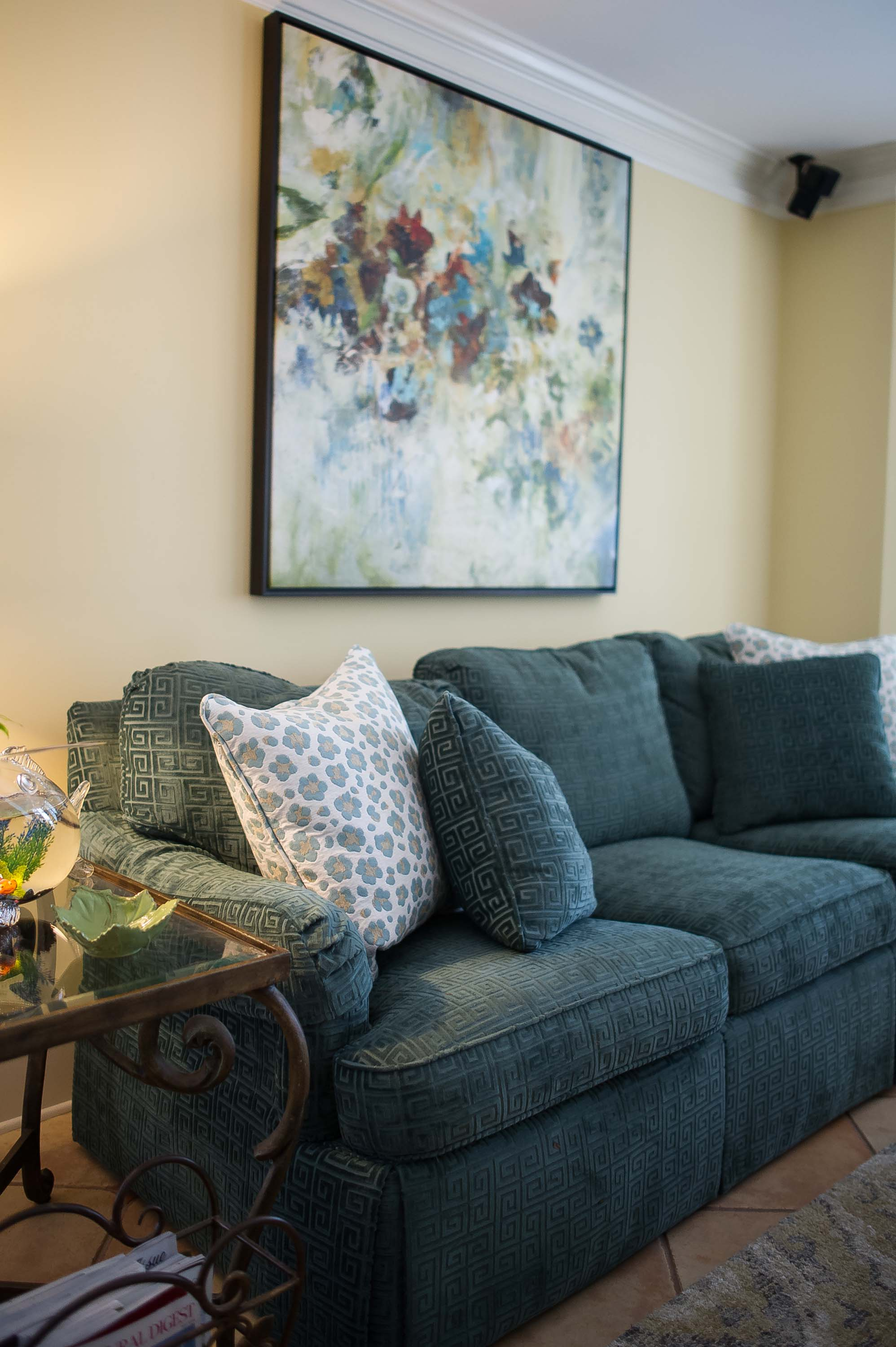 Living room with sofa, set of pillows and artwork on the wall