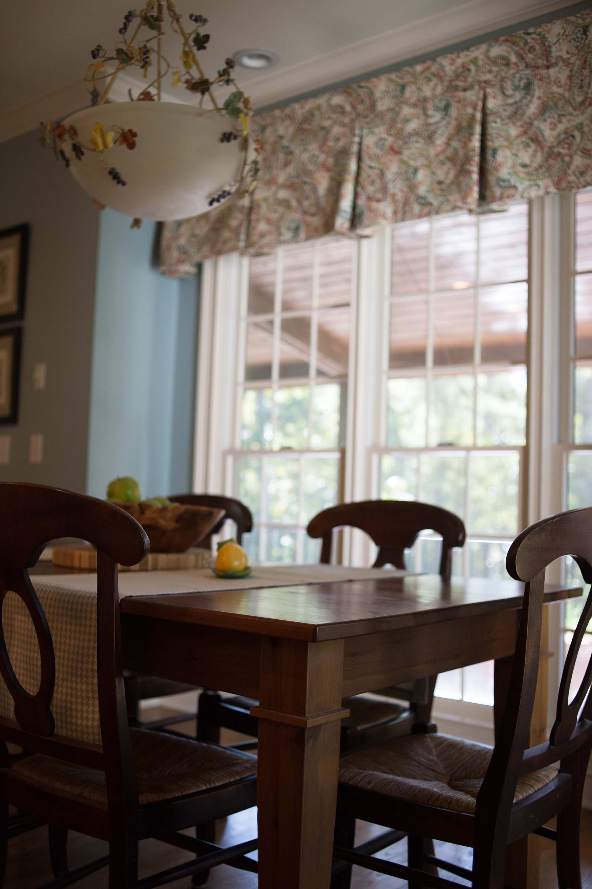 Dining room with wooden table and soft seat chairs