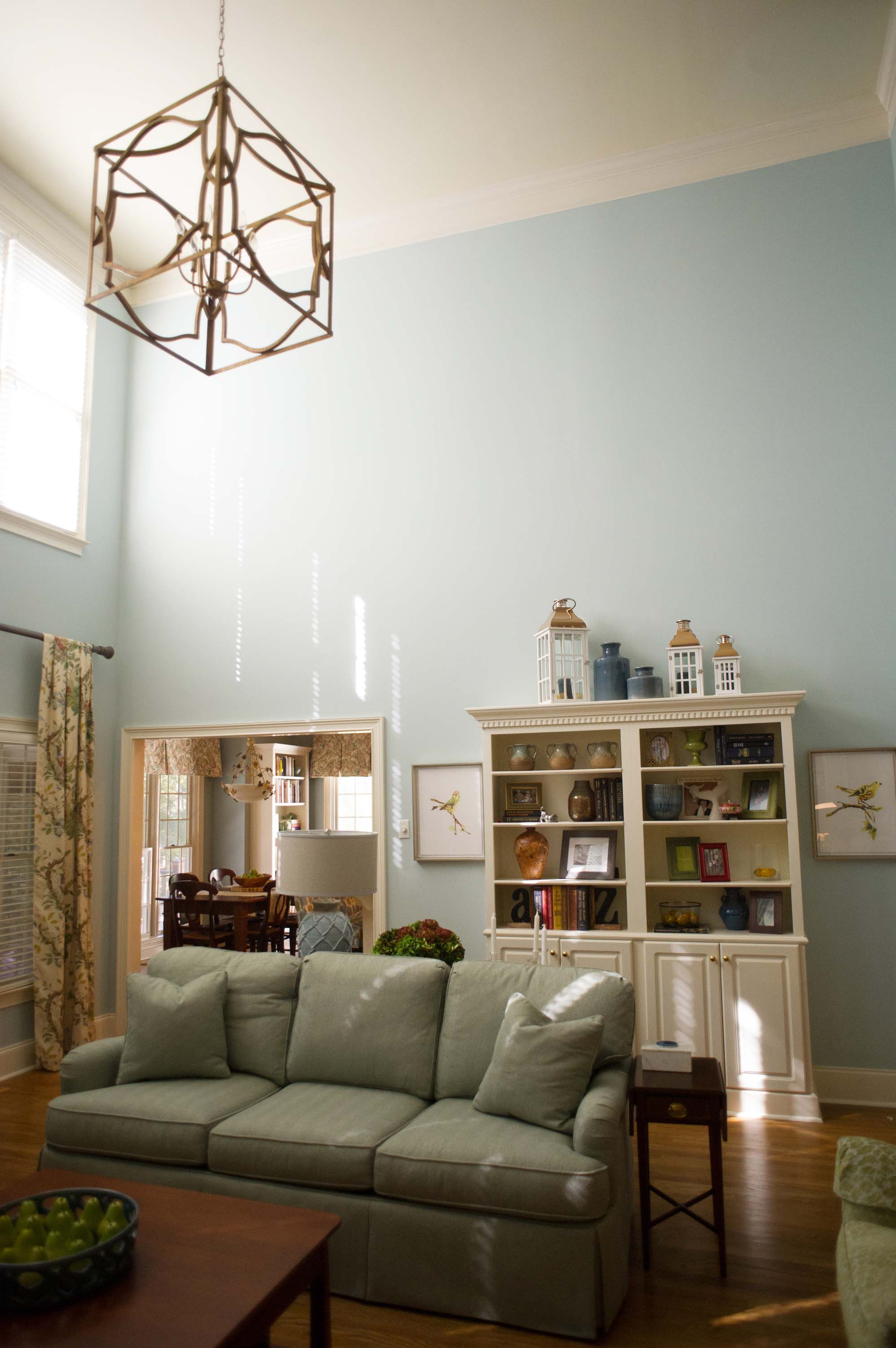 Living room with high ceiling and pastel painted wall