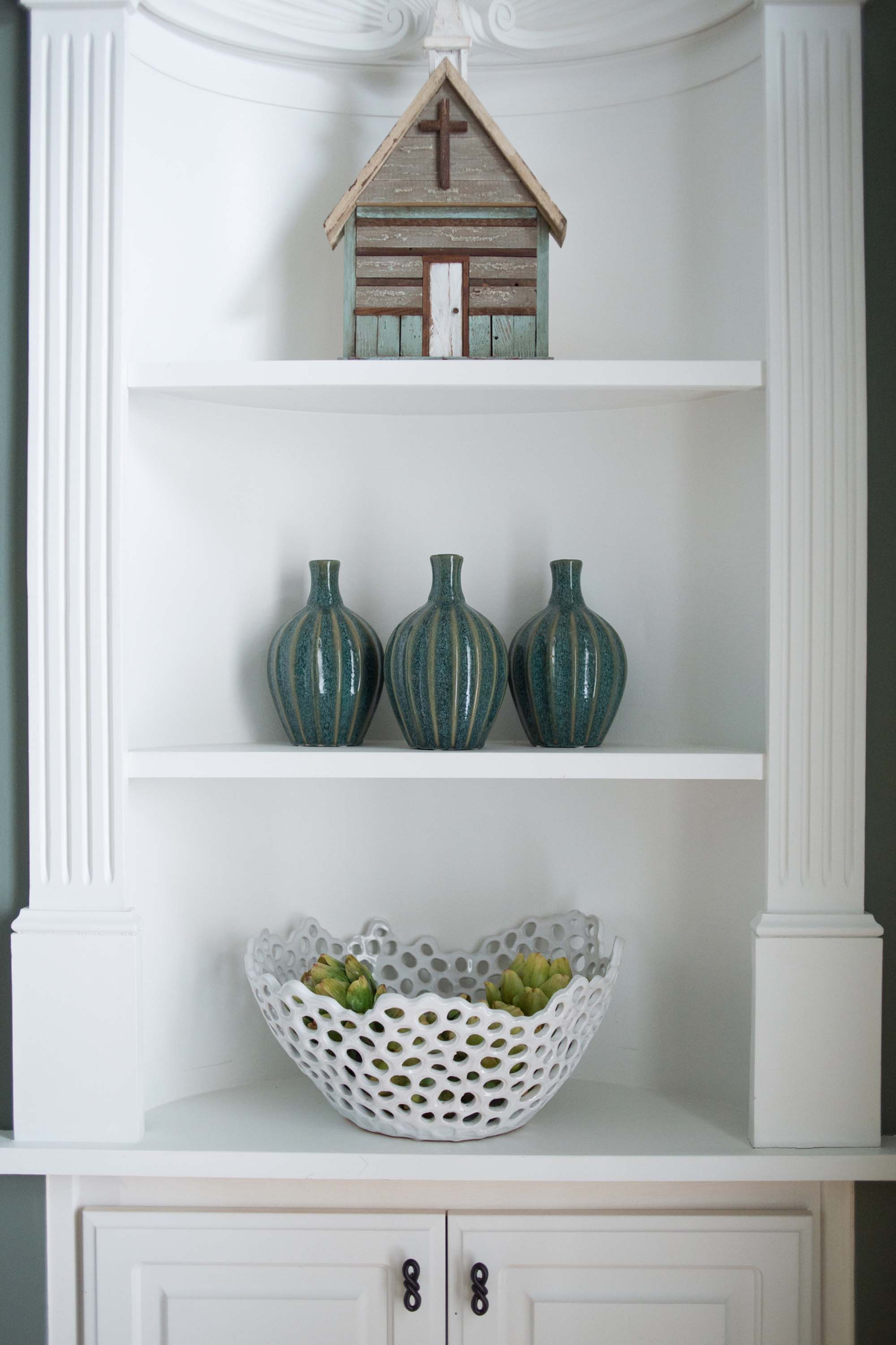 Shelves with miniature chapel, vase and basket