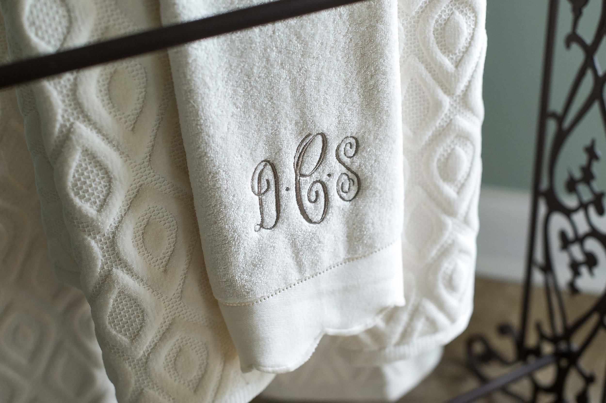 Bath towel with embroidered initials