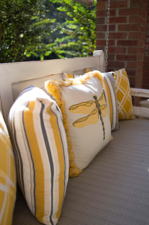 Set of yellow pillows on hanging sofa