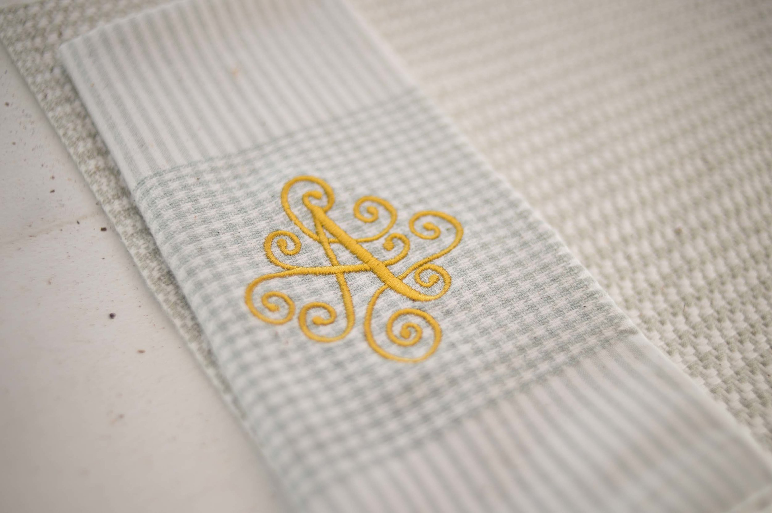 Embroidered initial on a fabric