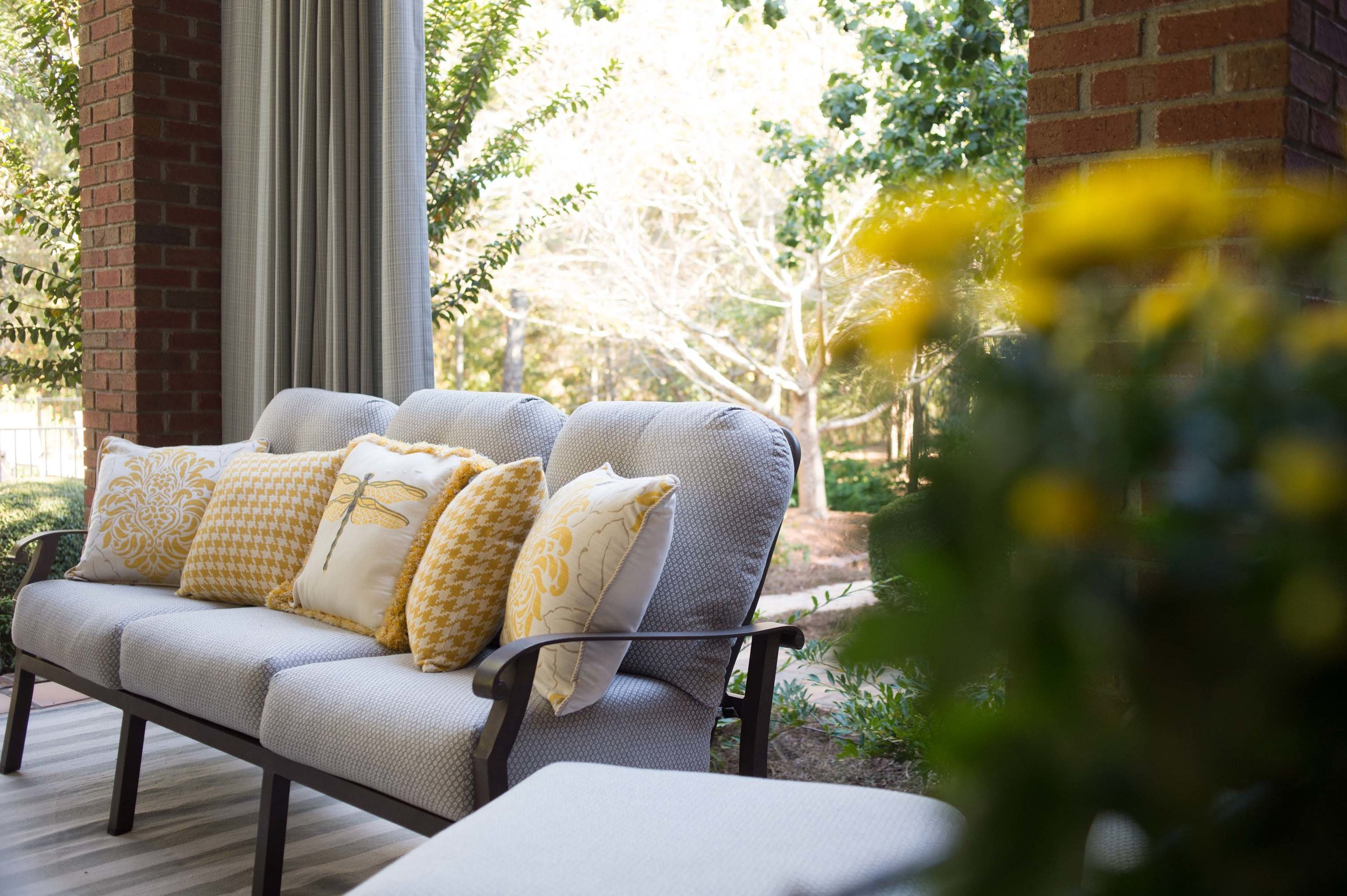 Outdoor patio with sofa and modern style center table
