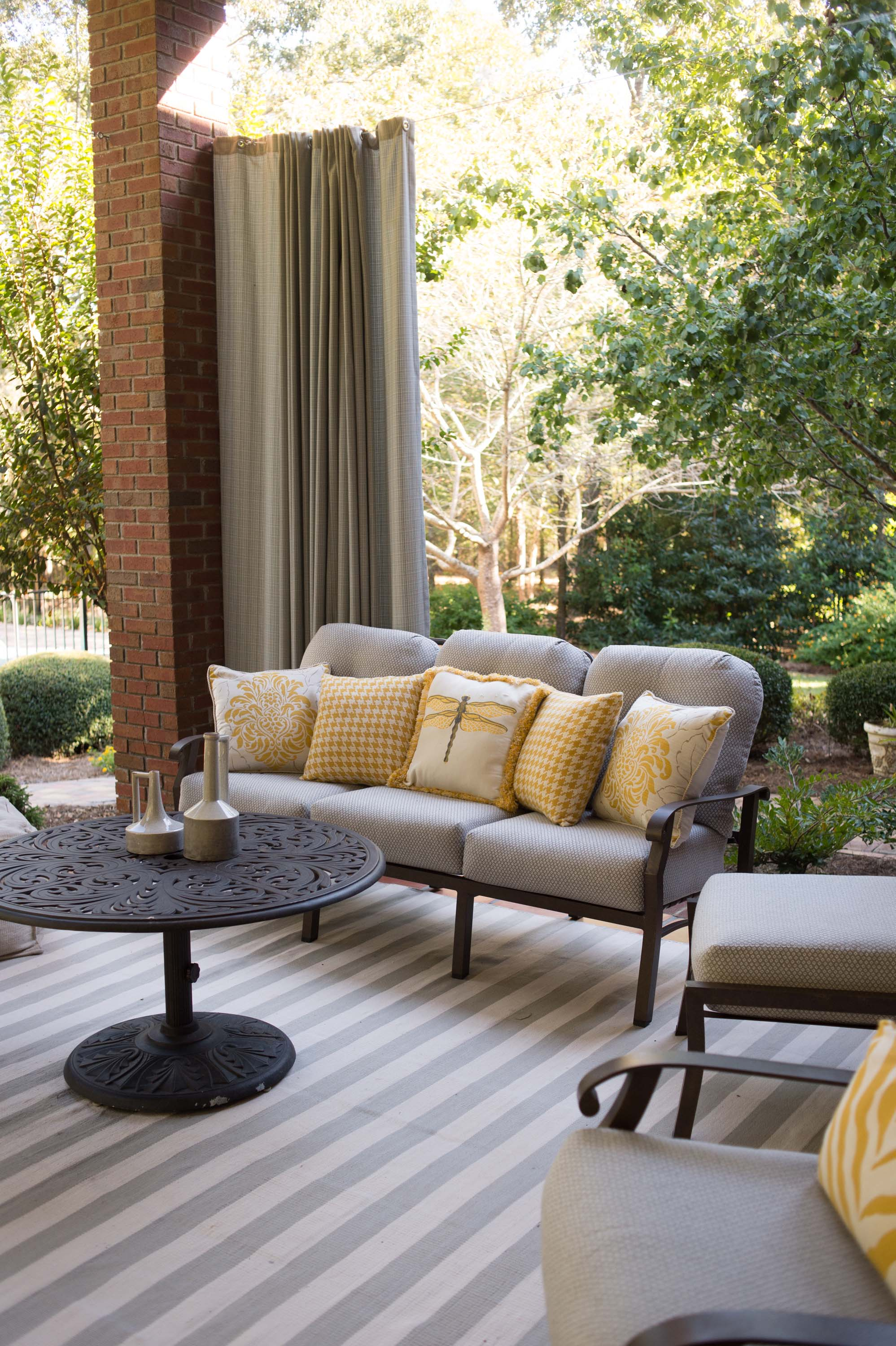 Outdoor patio with set of pillows on sofa