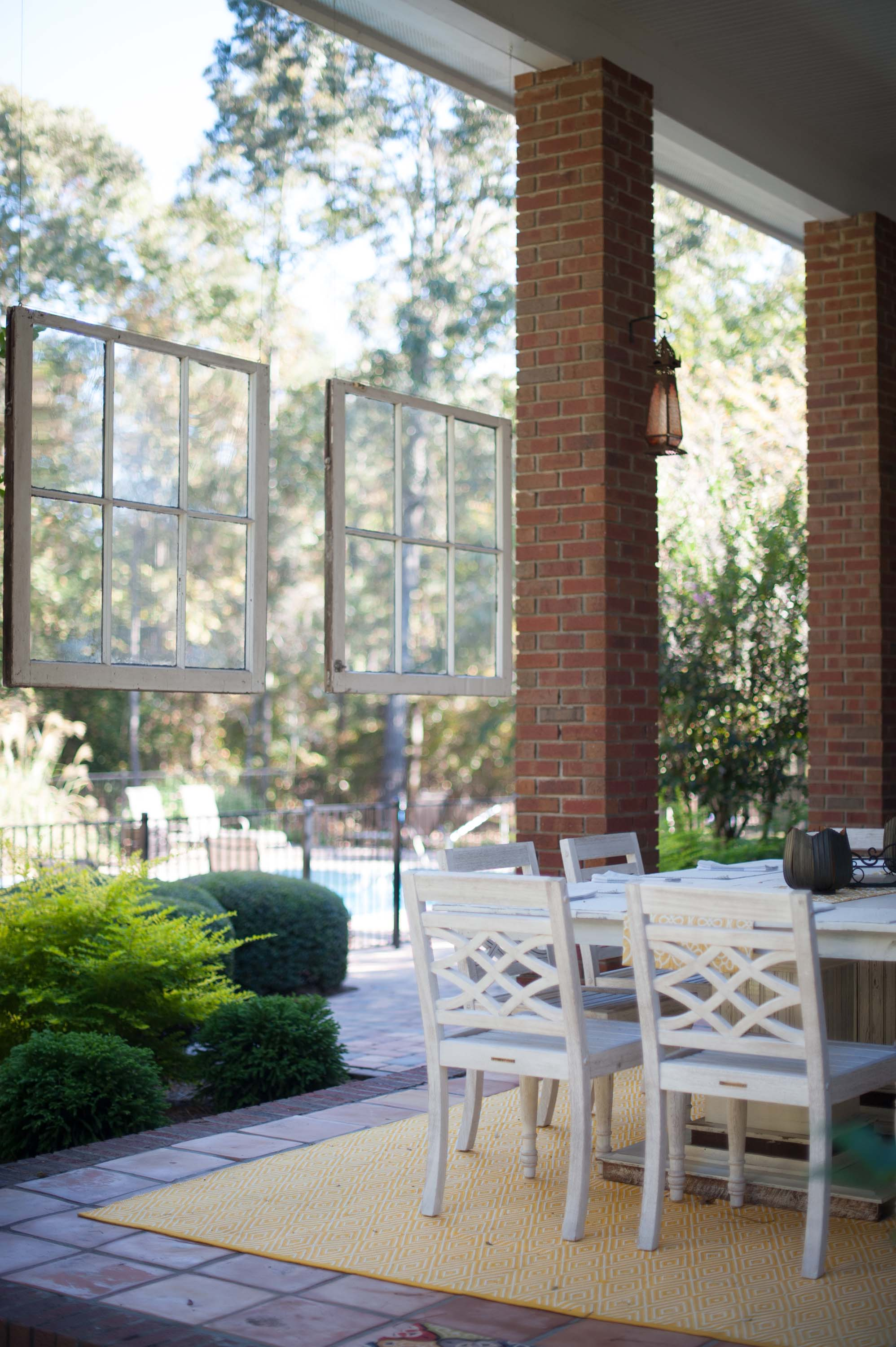 Outdoor patio with dining table and wooden chairs