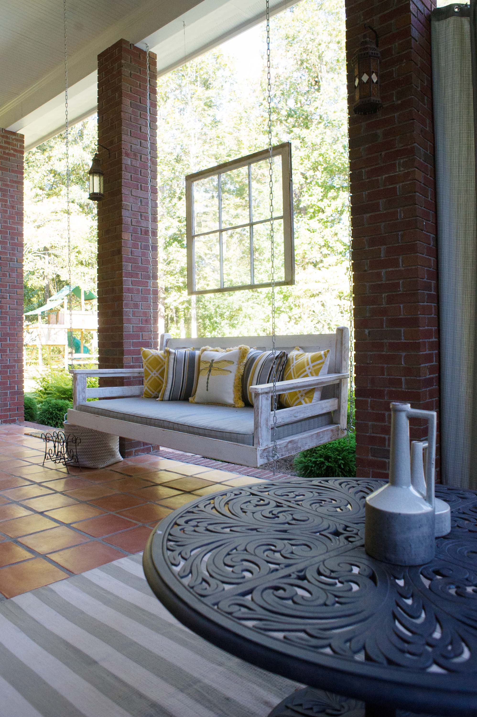 Outdoor patio with hanging sofa and modern style round table