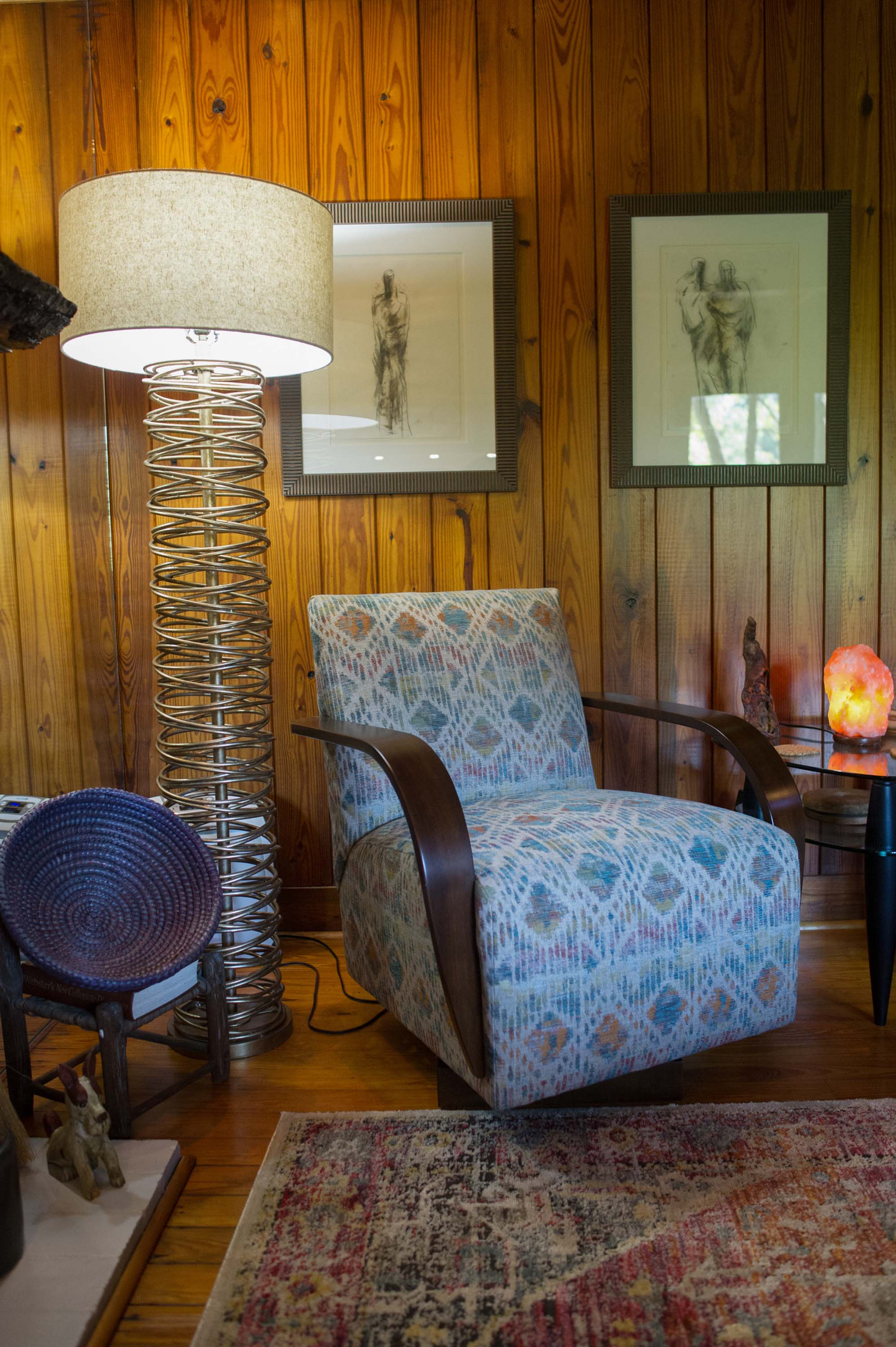 Swivel Chair with Floor Lamp, 2 pieces of artwork & large area rug.