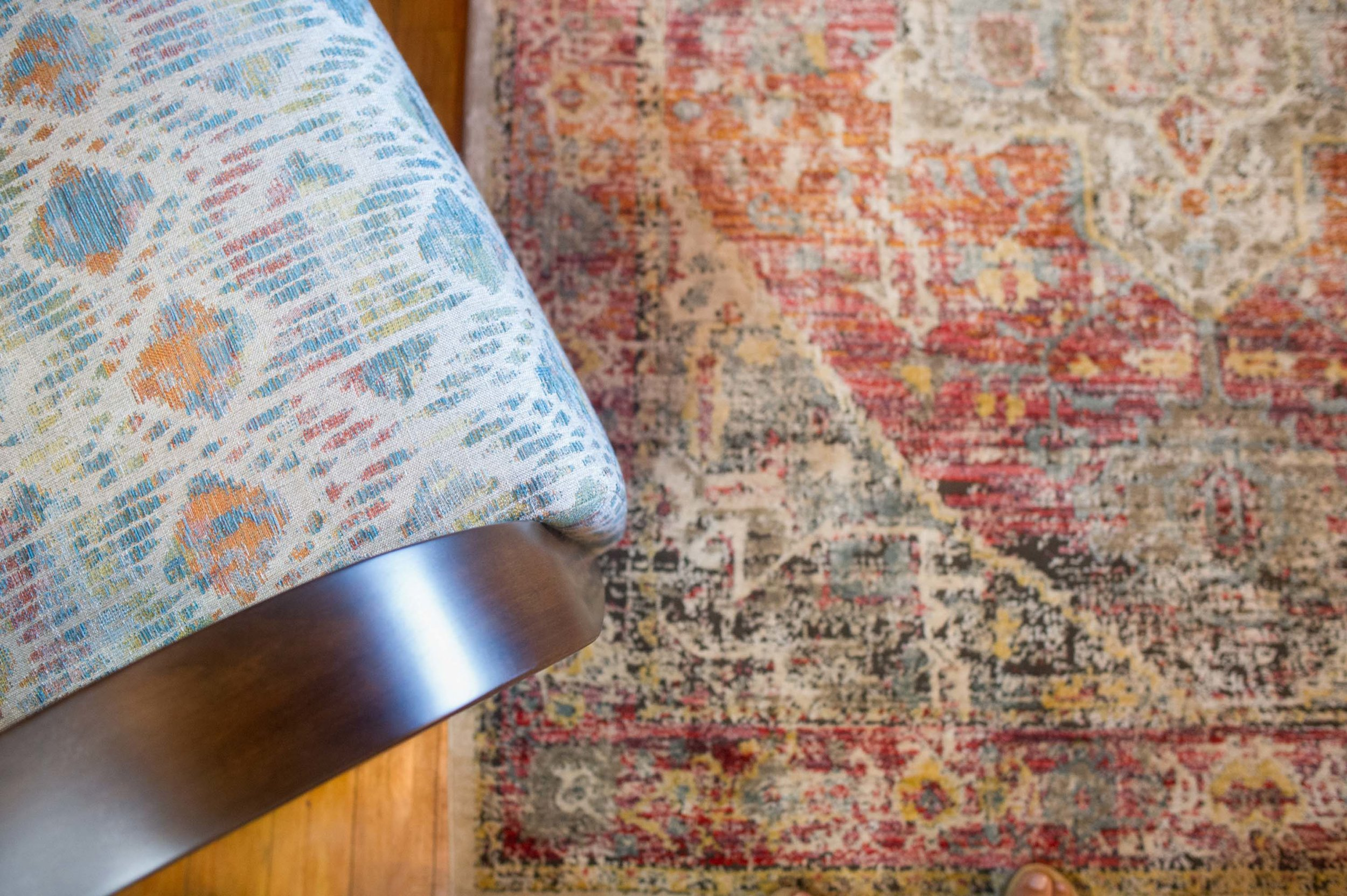 Detailed Loloi area rug with Norwalk Besie Swivel Chair