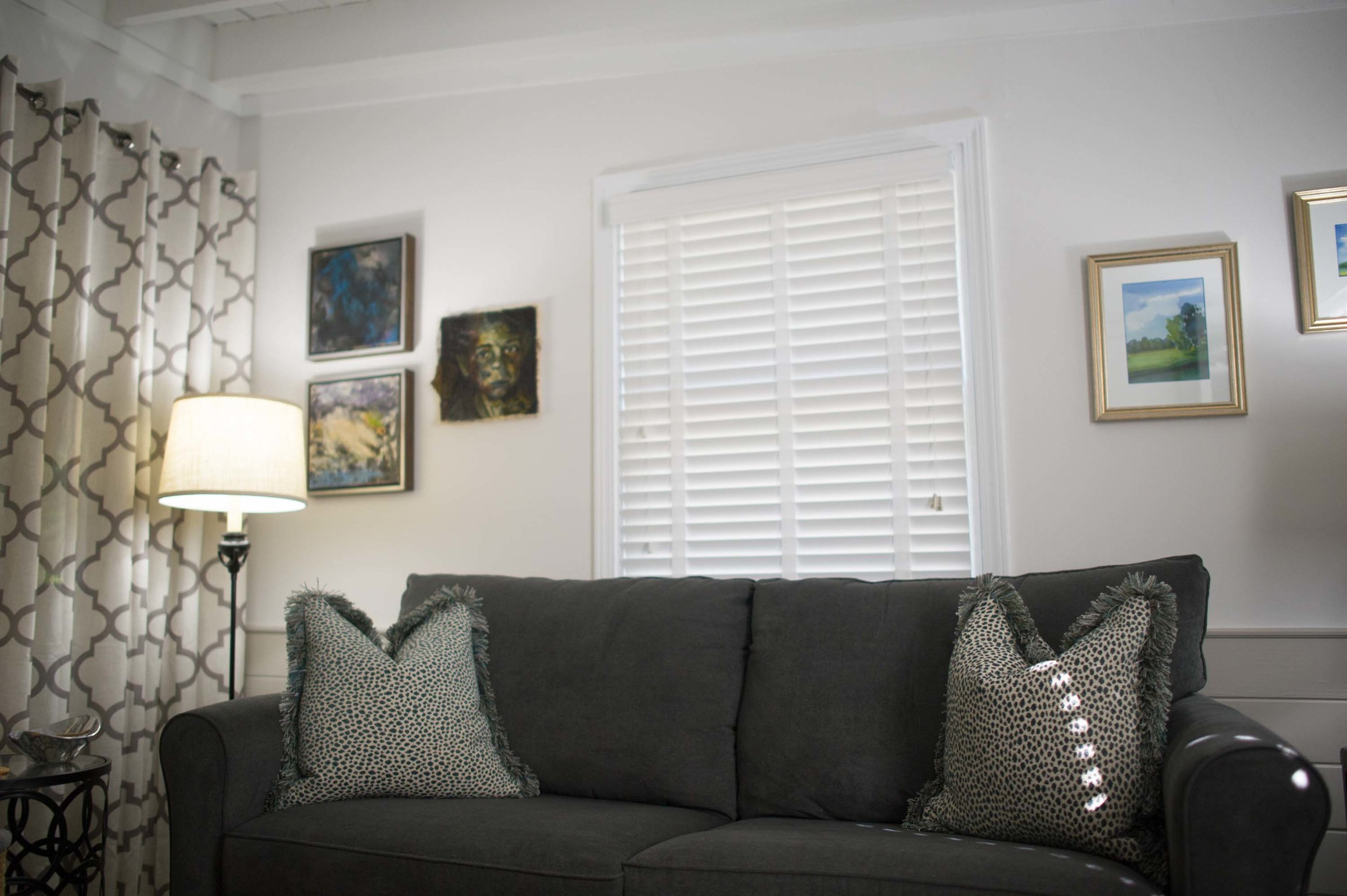 Sitting Room with Sofa, Artwork, Lamps & Window Treatments