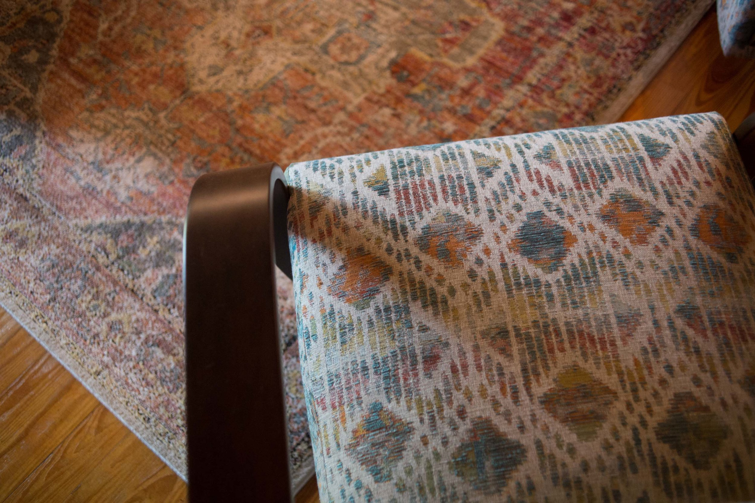Loloi Printed Rug with Besie Swivel Chair Printed fabric.