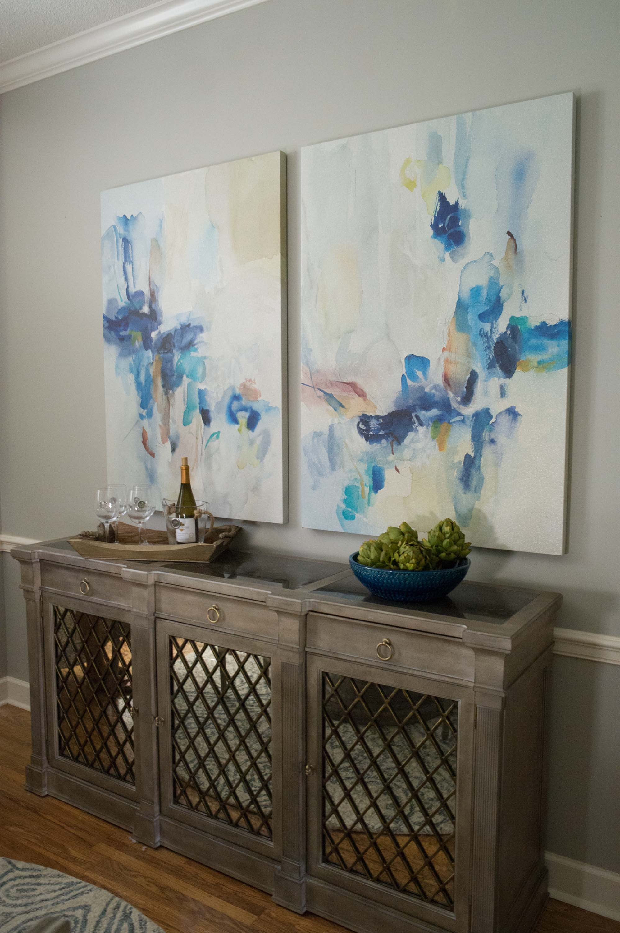 Dining Room Buffet with Artwork, Wine Glasses & Artichokes