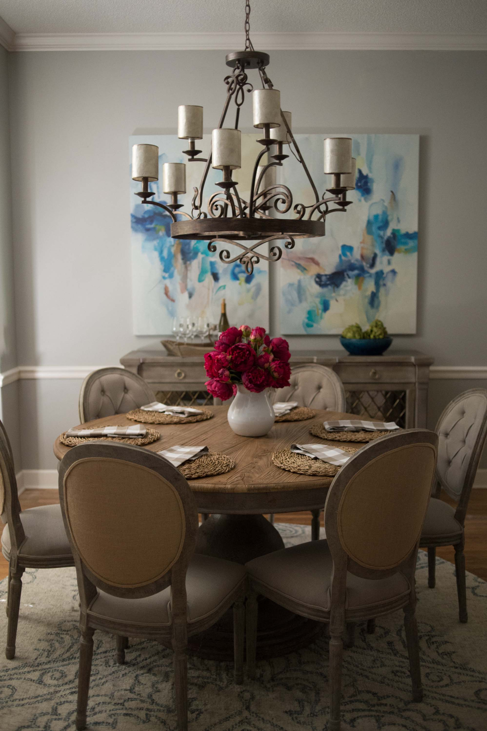 Dining Room Table with Light Fixture, Artwork, Chairs & Centerpiece
