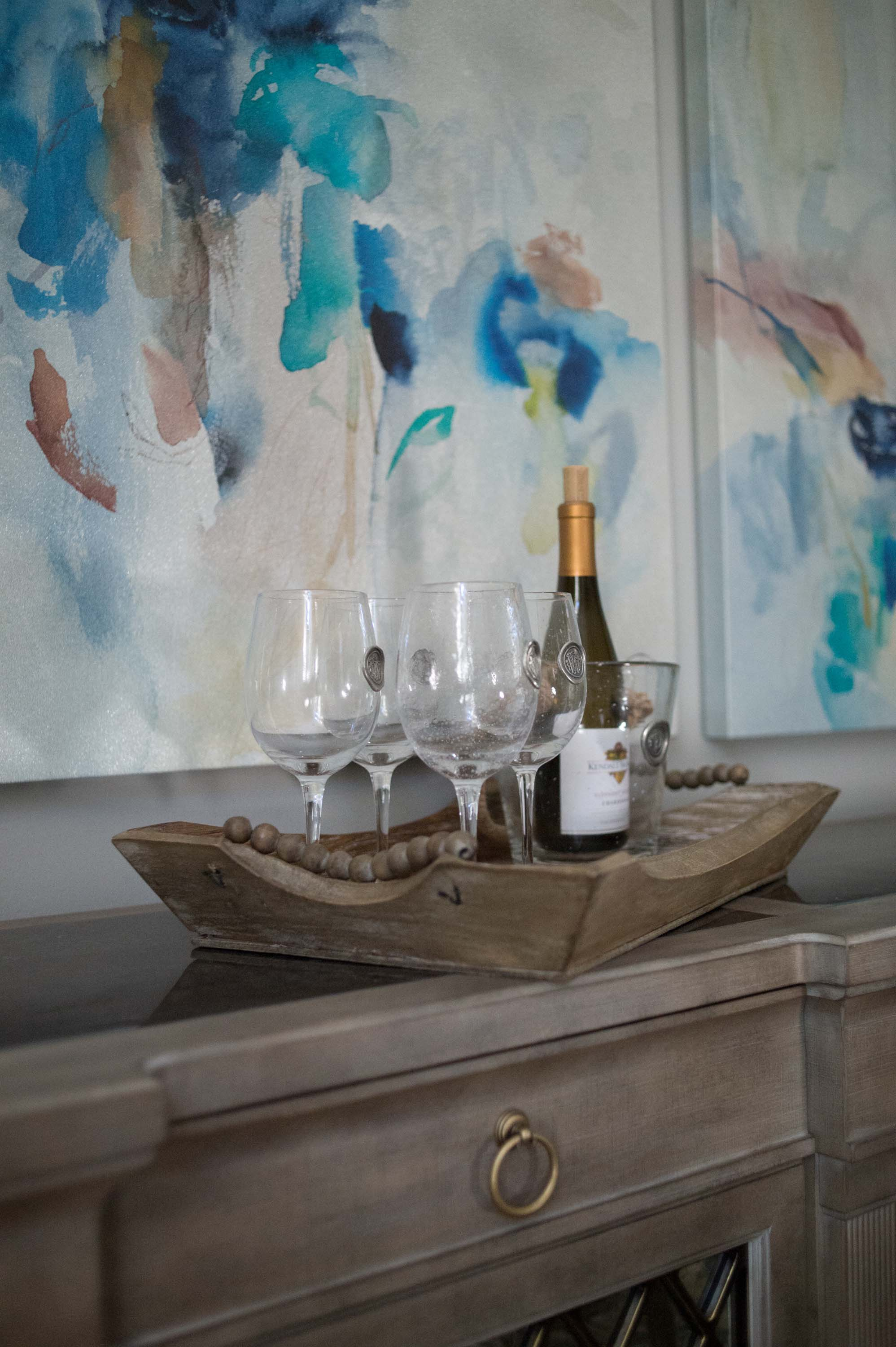 Dining Room Buffet with Wine Glasses & Contemporary Artwork