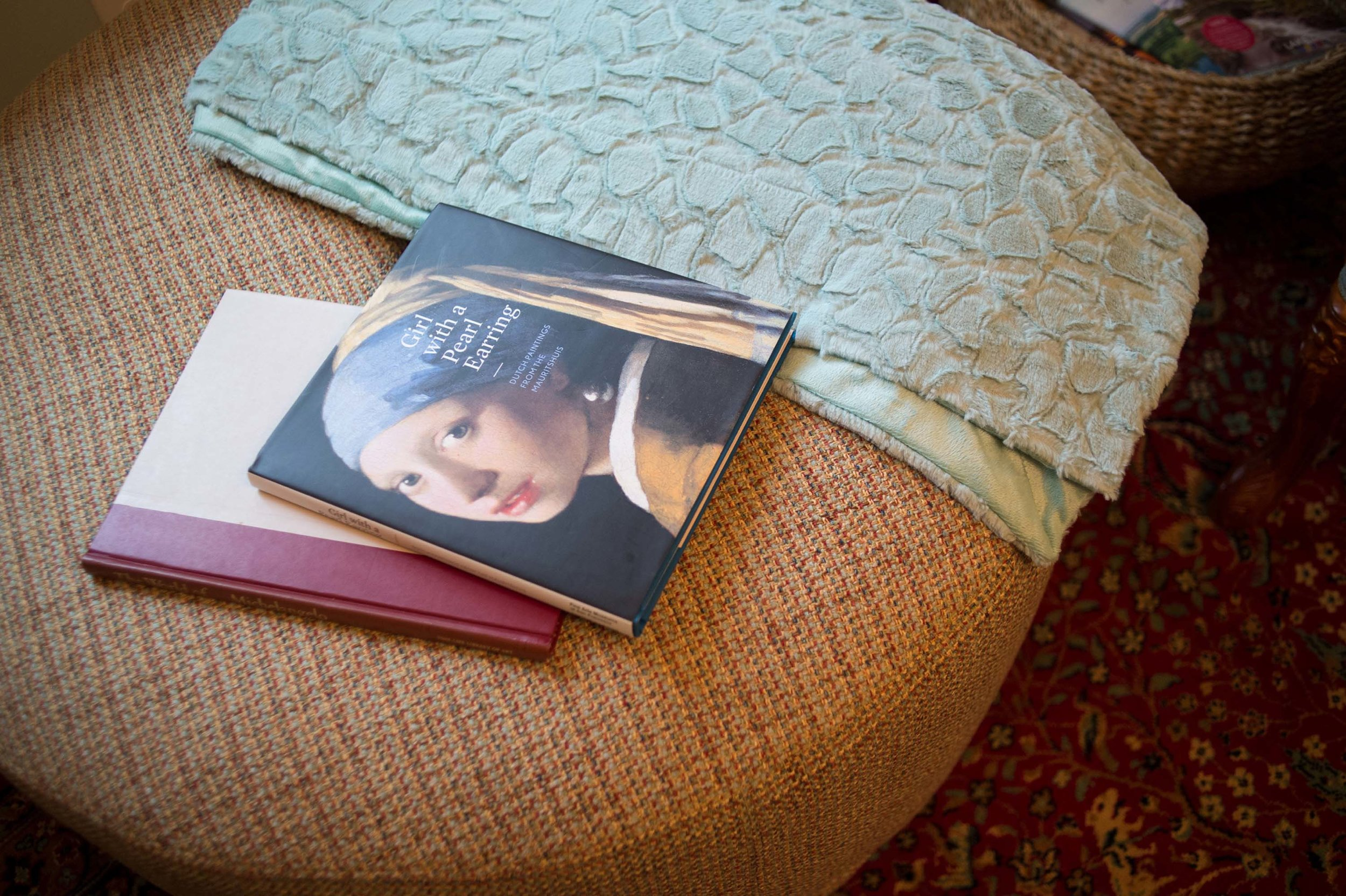 Ottoman Accessories to include books and Blanket