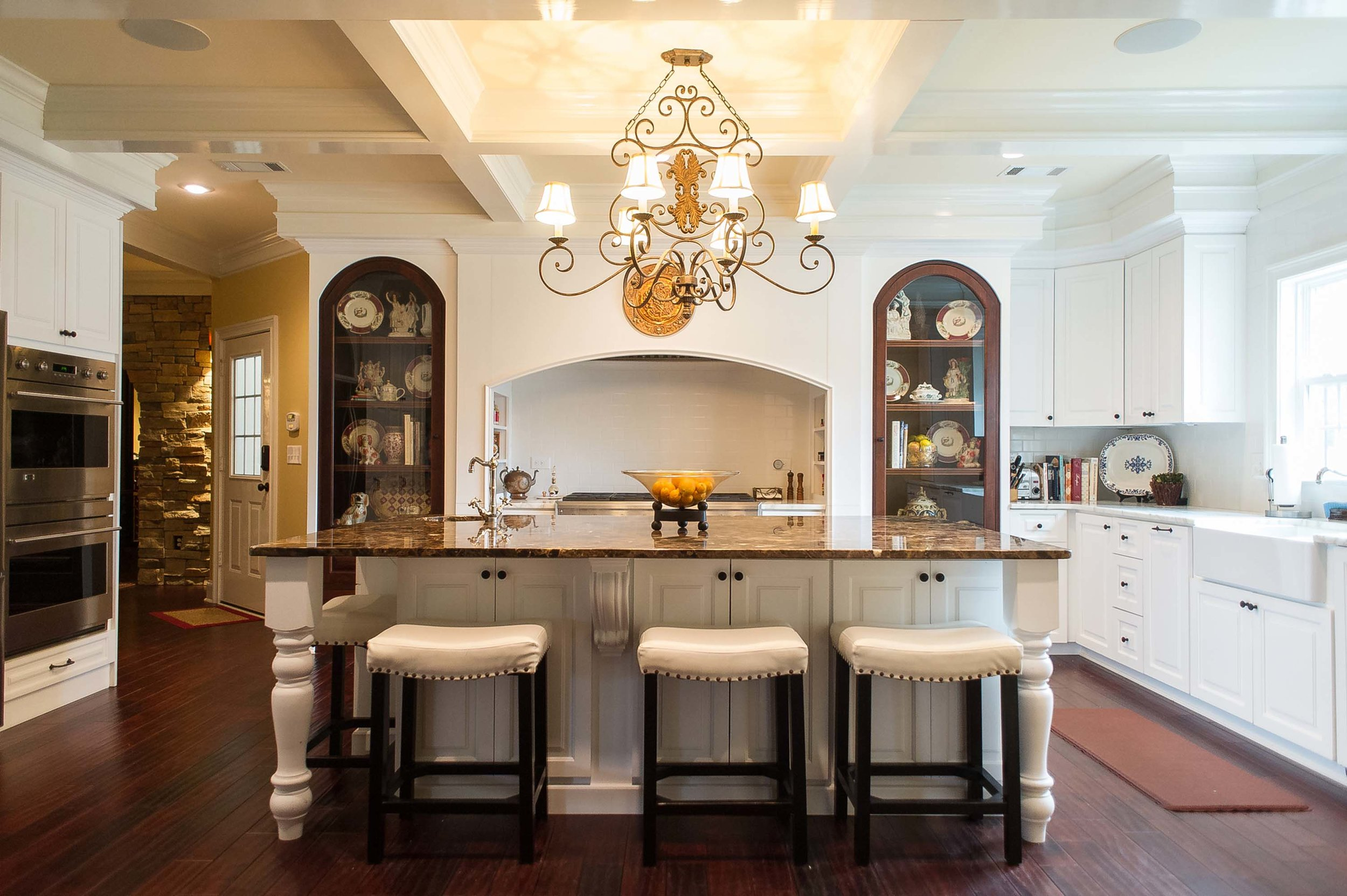 Large Kitchen Area with Barstools and Chandelier
