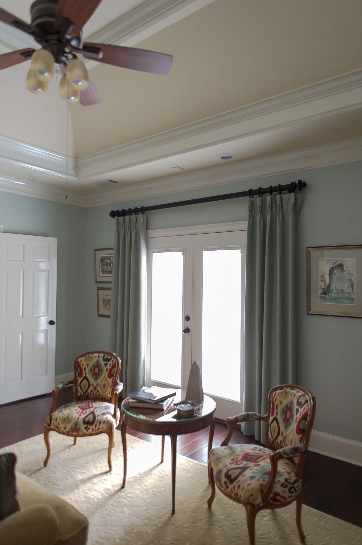Sitting Room with 2 Custom Chairs, Hardwood, Large Area Rug & Window Panels