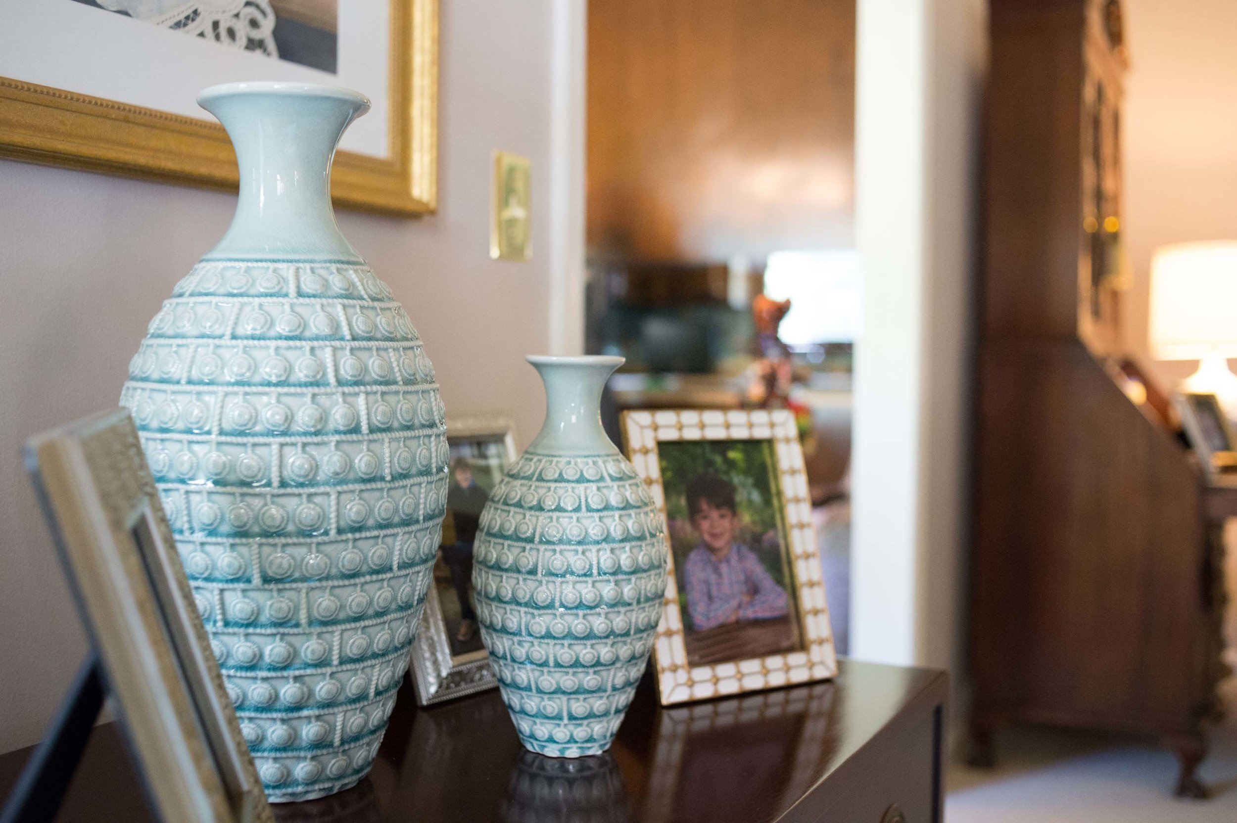 Light Blue Vases in Living Room with Picture Frames