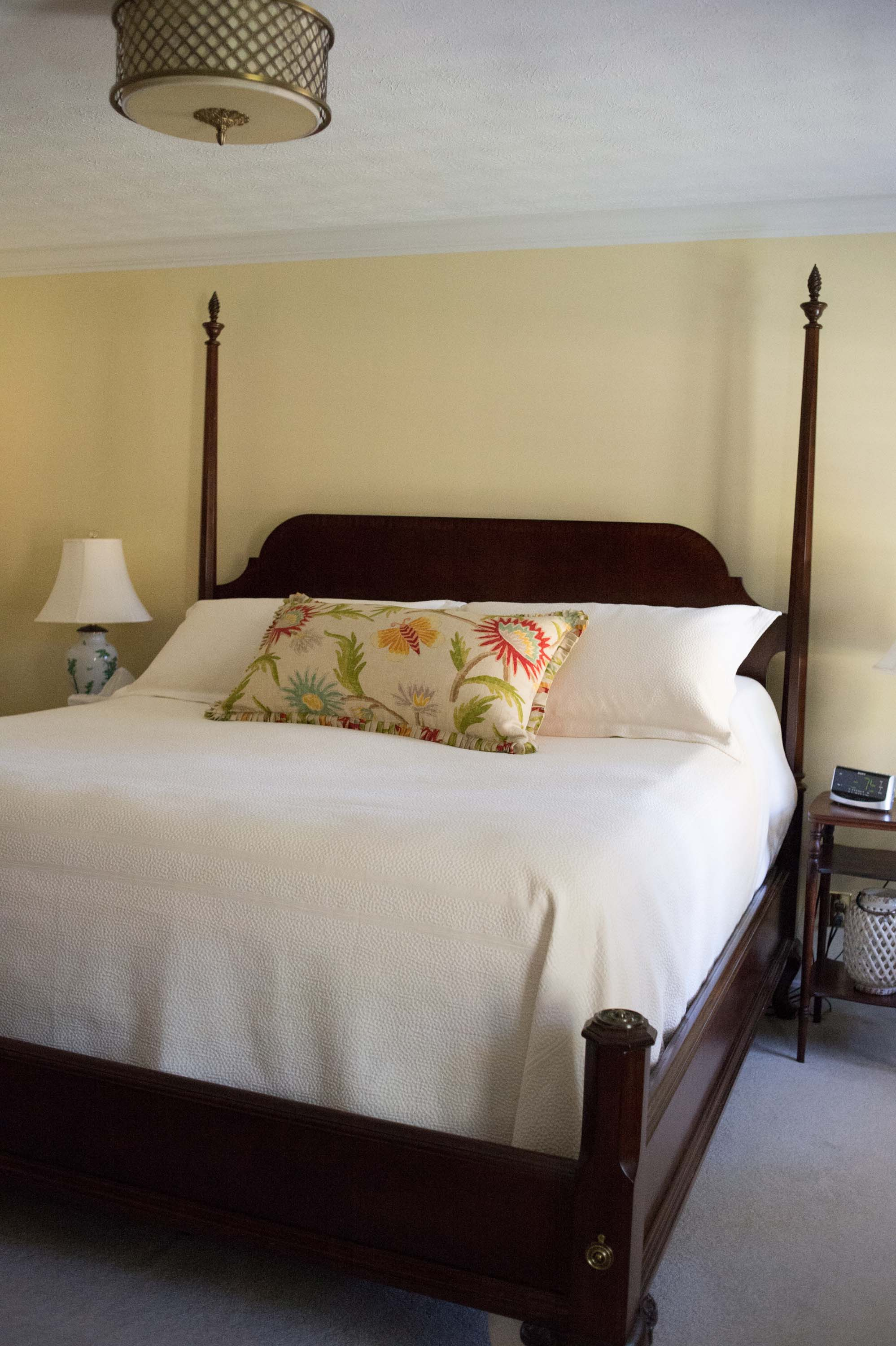 Yellow Master Bedroom with King Bed, Custom Pillow, Lamps and Chandelier