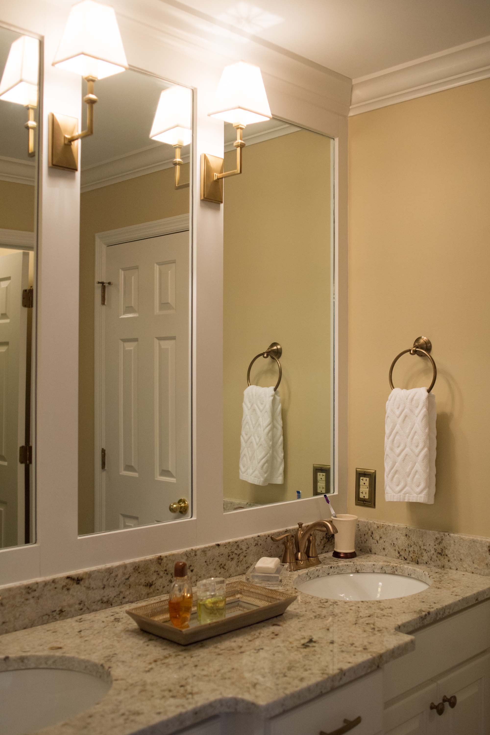 Yellow Bathroom with updated vanity, faucets, mirrors and fixtures