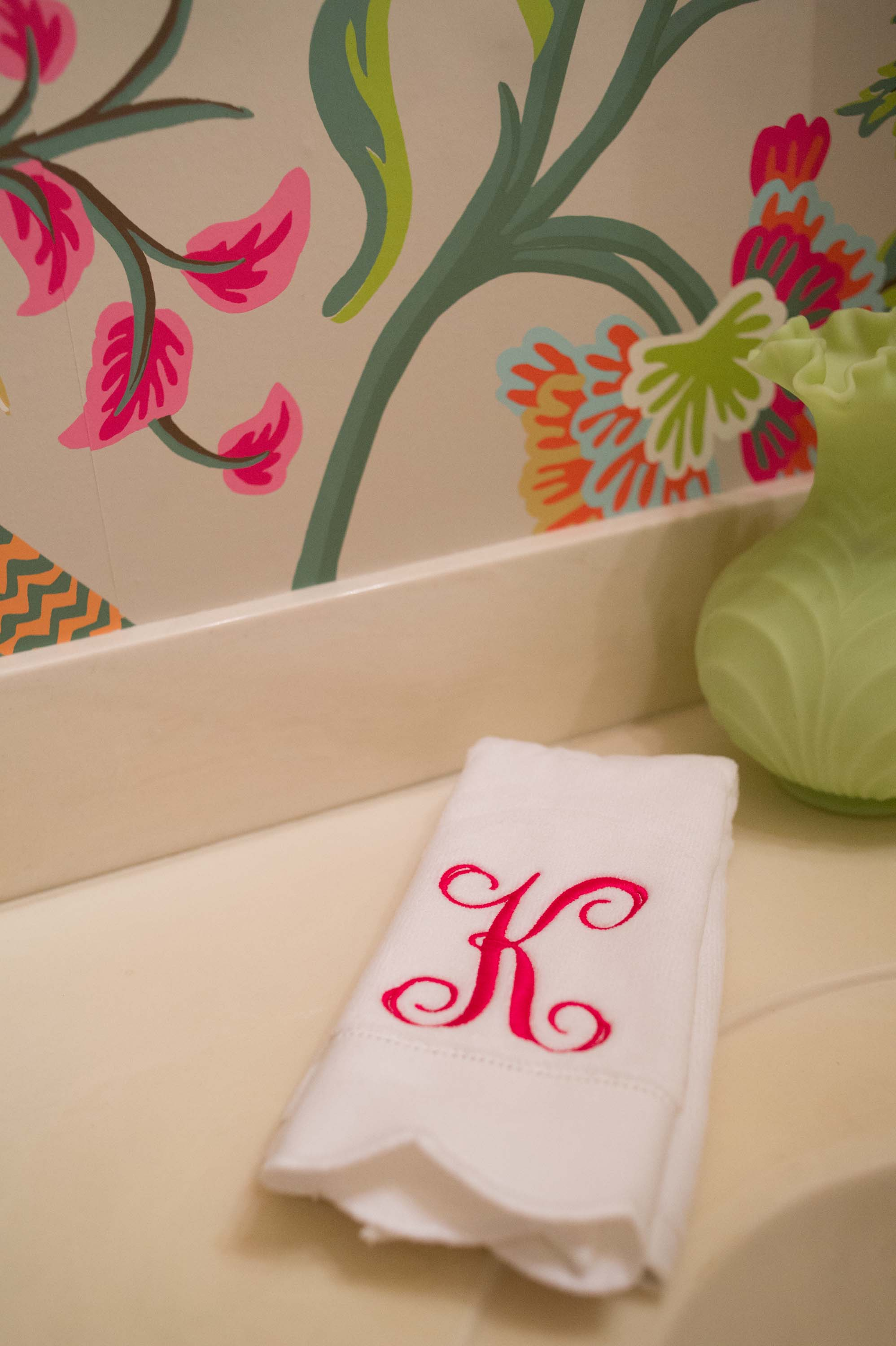 Thibaut wallpaper with monogrammed towel.