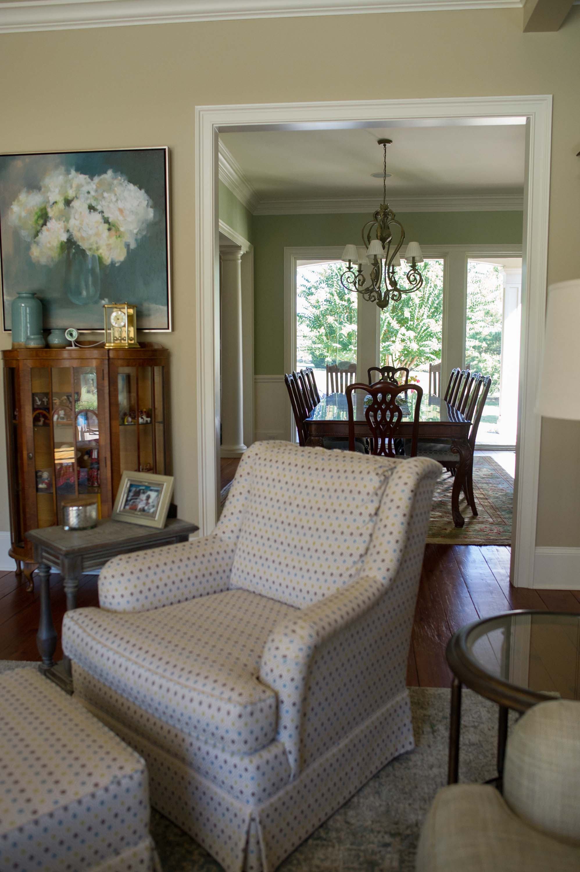 Sherrill Furniture Chair and ottoman with Leftbank Artwork and Large Area Rug