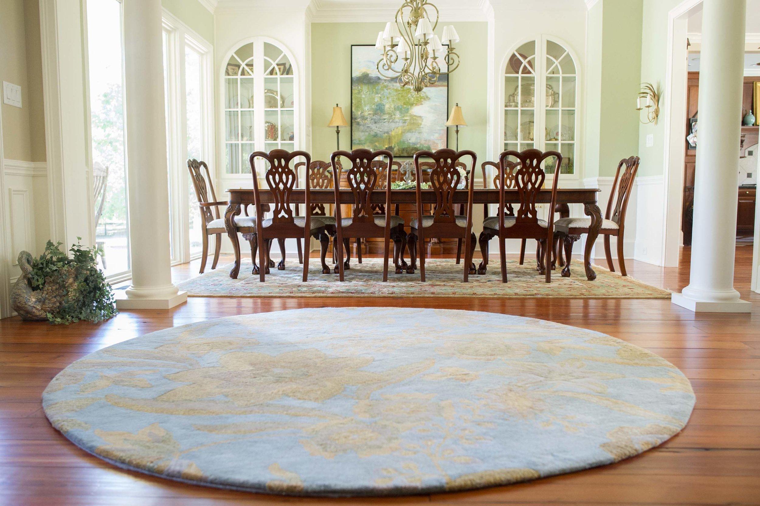 Dining Room with Jaunty Round Rug and Leftbank Artwork