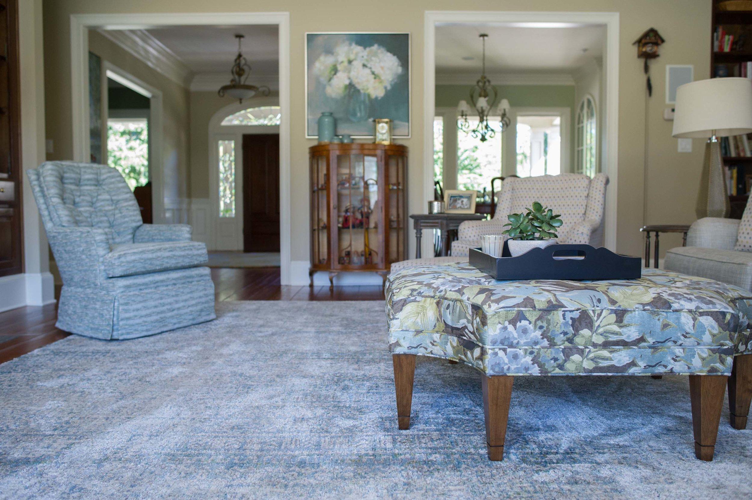Great Room with Swivel Chair, Norwalk Ottoman, Loloi Rug & Artwork