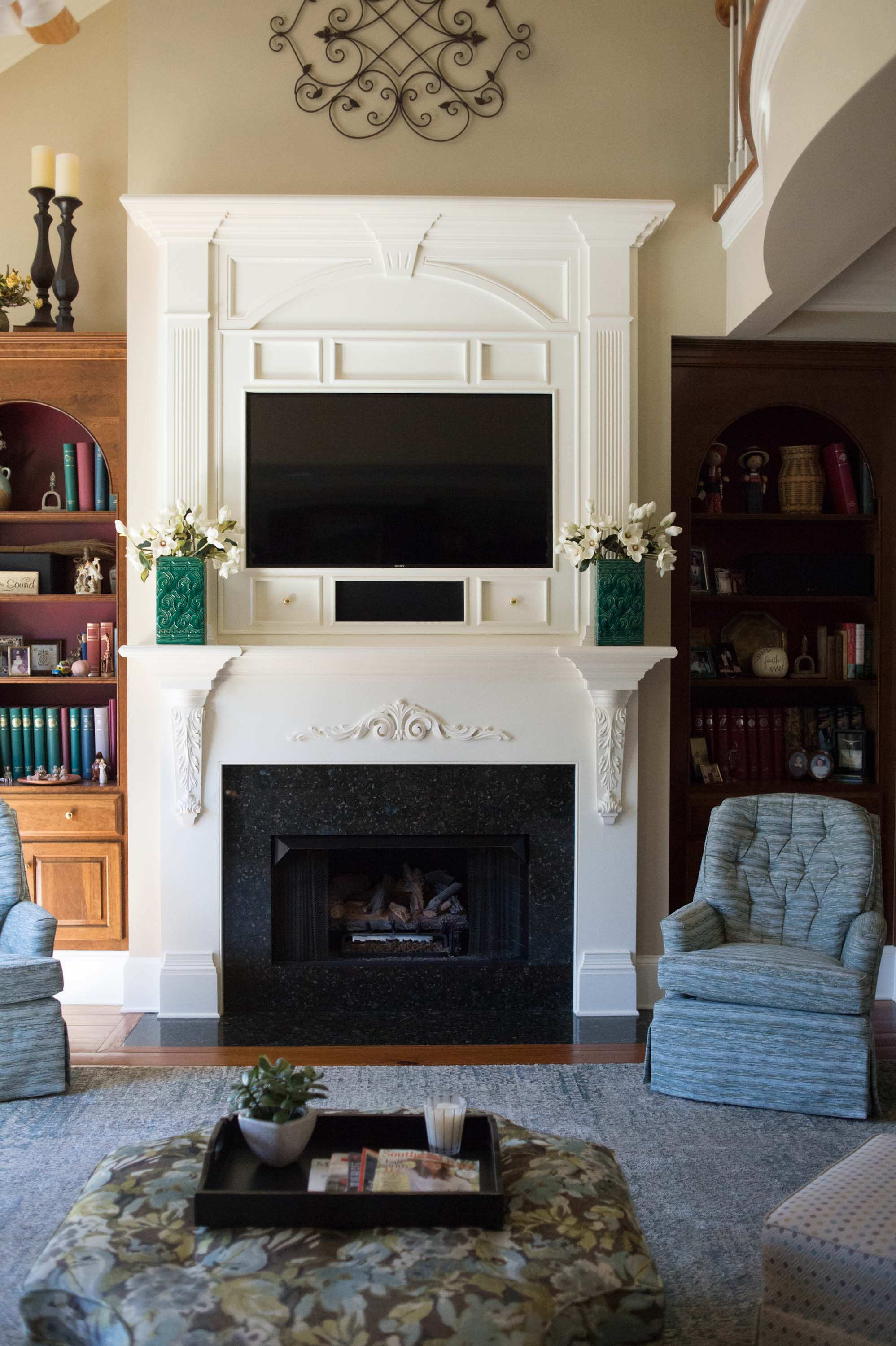 Fireplace with Custom Bookshelves with Accessories and Reupholstered Swivel Chairs