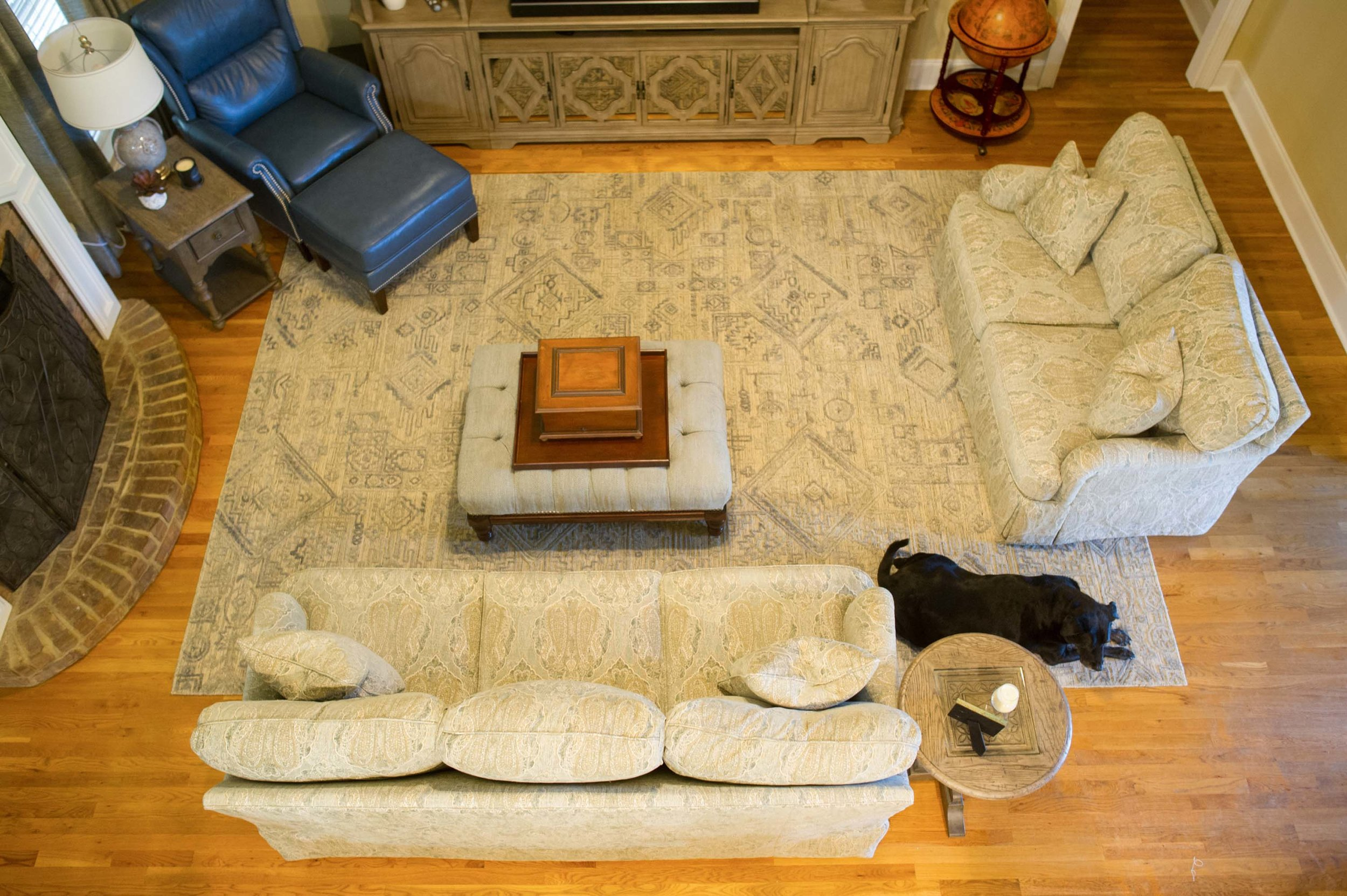 Overhead shot of Sofa, Large Area Rug, Loveseat, and Recliner