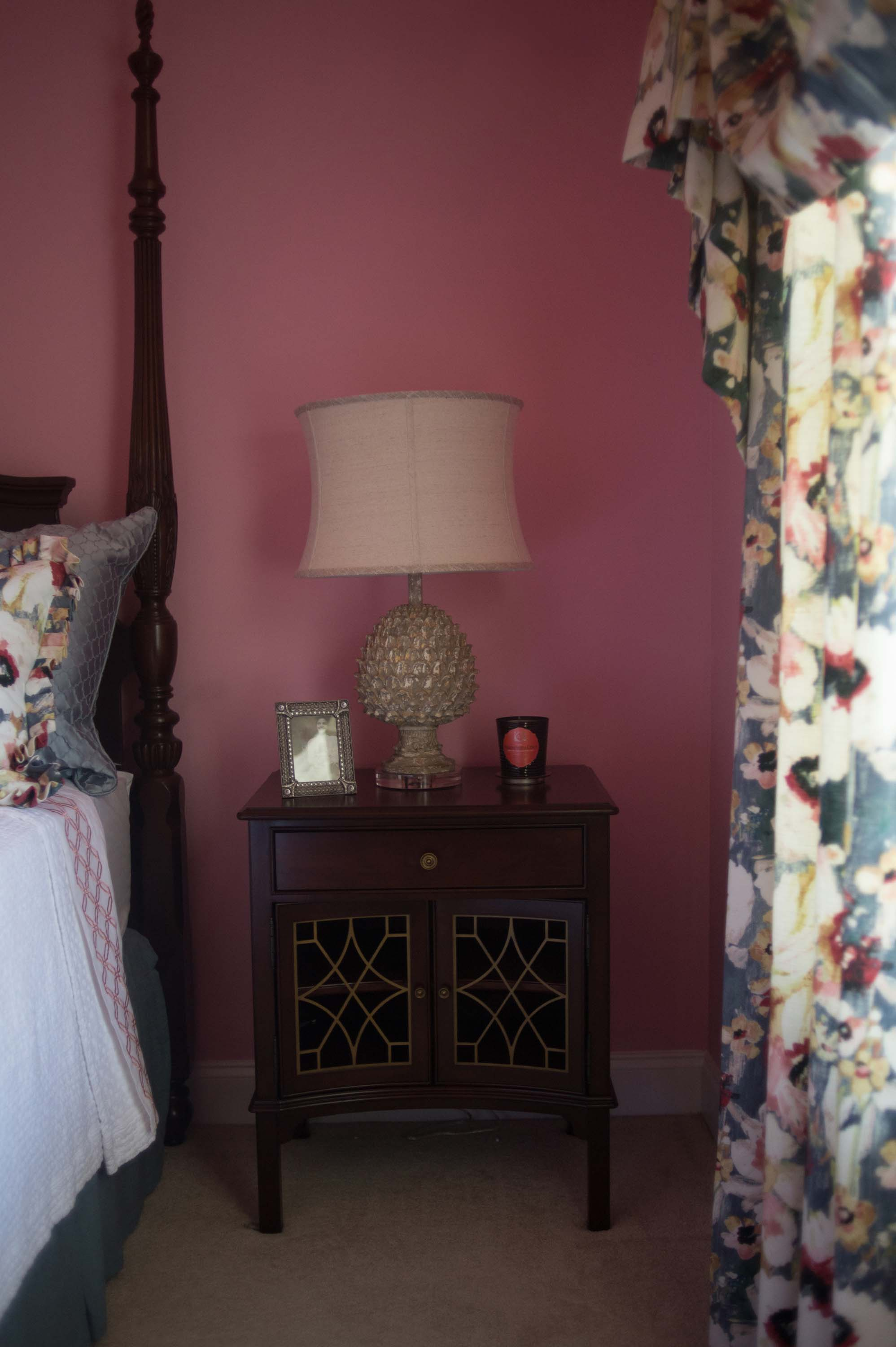Pink walls with lamp and custom window treatments