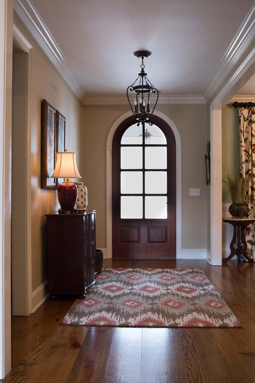 Entryway with Printed Rug, Lamp, Doorway & Chandelier