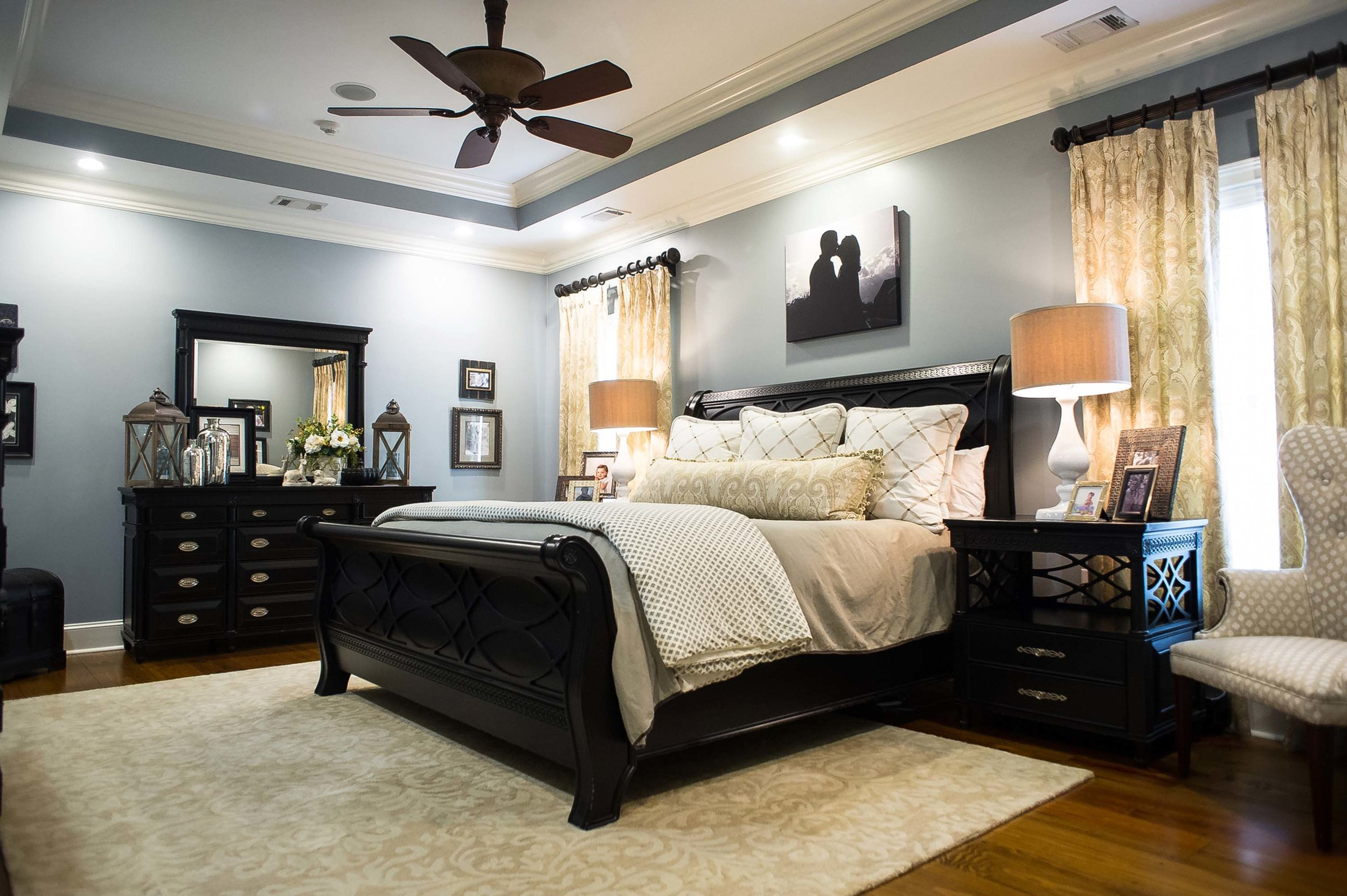 Master Bedroom with Custom Bedding, Large Area Rug and Window Treatments