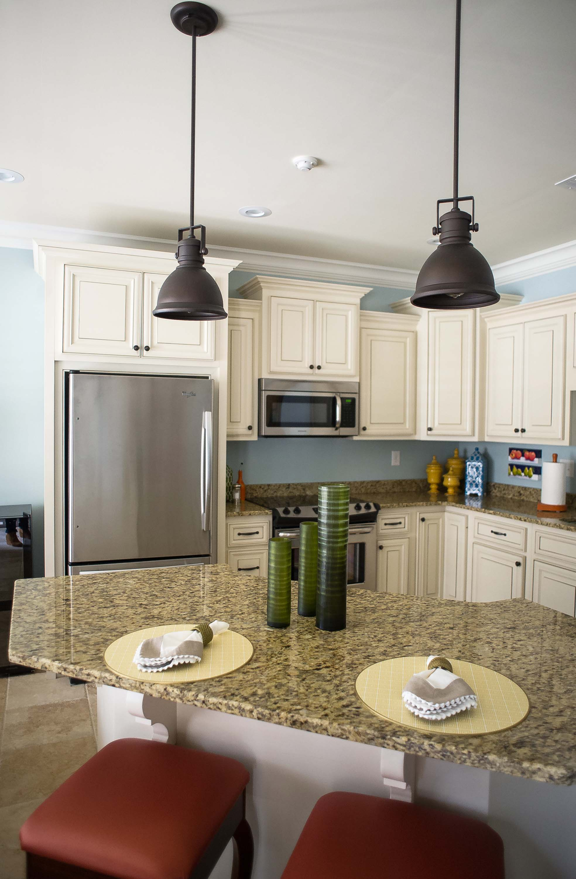 Cream Kitchen Cabinets with Pendant Lighting
