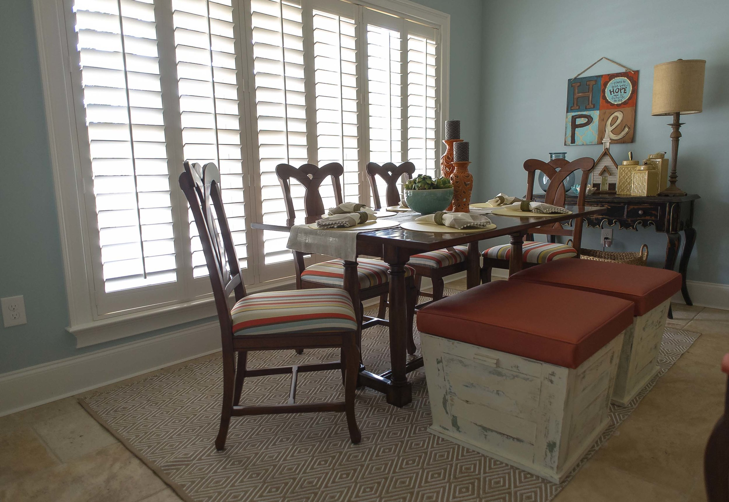 Reupholstered Chairs and Bench Seating Around Wooden Table